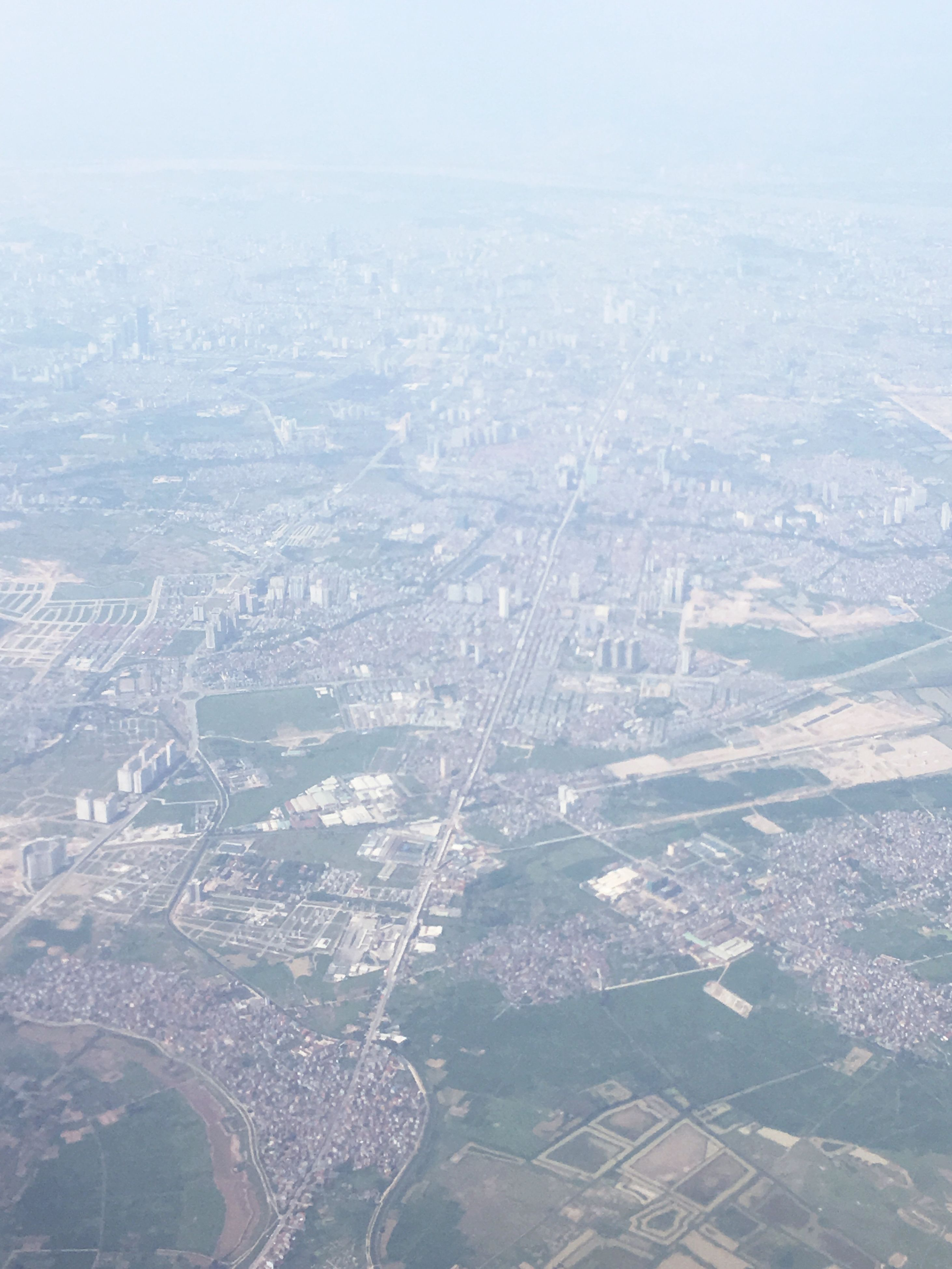 aerial view, city, cityscape, landscape, built structure, architecture, travel destinations, building exterior, crowded, fog, day, outdoors, scenics, nature, sky, foggy, tranquil scene, majestic, wide shot, development, physical geography, tranquility, non-urban scene, beauty in nature, city life, tourism, cloud - sky, horizon, no people, residential district, distant