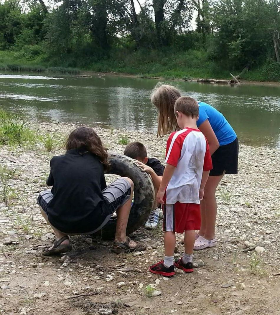 Kids find tire clean river nature environment make a difference Ohio, USA Whitewater River Environment Making A Difference Children Youth Of Today