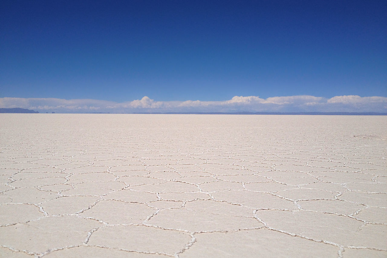 Salar de Uyuni, Bolivia. Photo taken with an iPhone 4s. Arid Climate Beauty In Nature Clear Sky Day Desert Extreme Terrain Landscape Nature No People Outdoors Salt - Mineral Salt Flat Salt Lake Sand Scenics