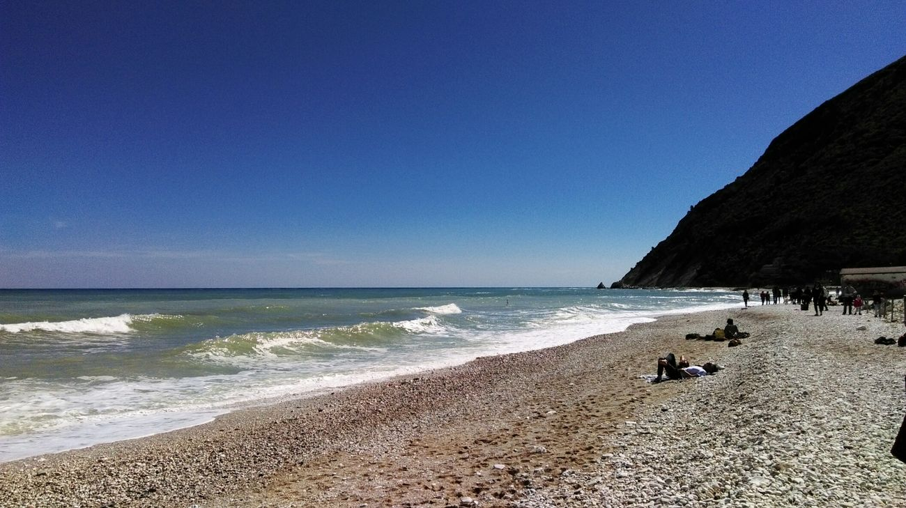 Beach Sea Water Sand Nature Horizon Over Water Beauty In Nature Sky Outdoors Clear Sky Wave Lifestyles My Point Of View Vacations Life Is A Beach No Filter Portonovo, Italy Baia Di Portonovo (an) Portonovo Monteconero Conero Summer Beautiful Wave Relaxing Moments