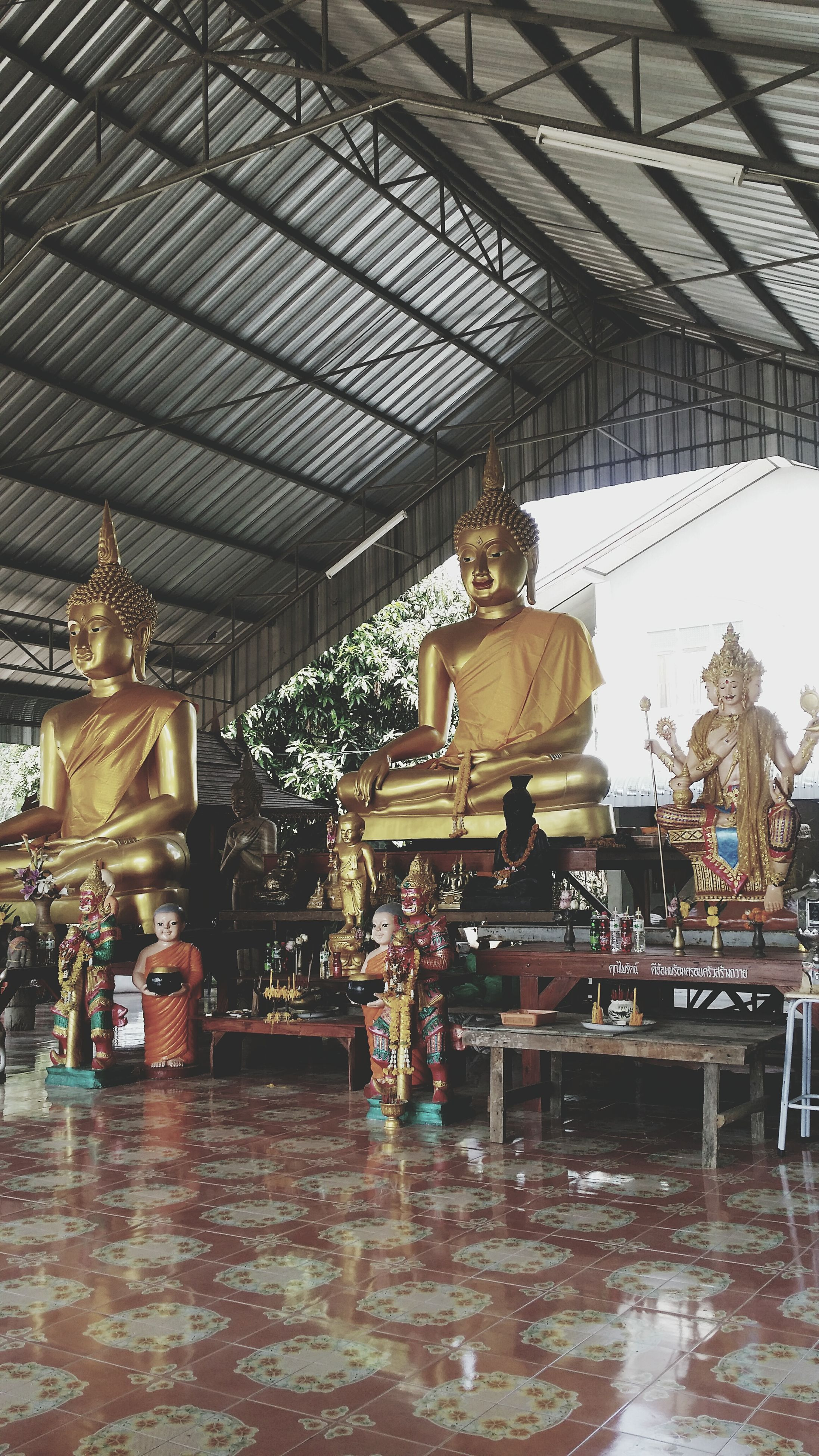 indoors, religion, place of worship, spirituality, temple - building, architecture, art and craft, built structure, statue, art, sculpture, human representation, creativity, tradition, cultures, ornate, decoration, temple
