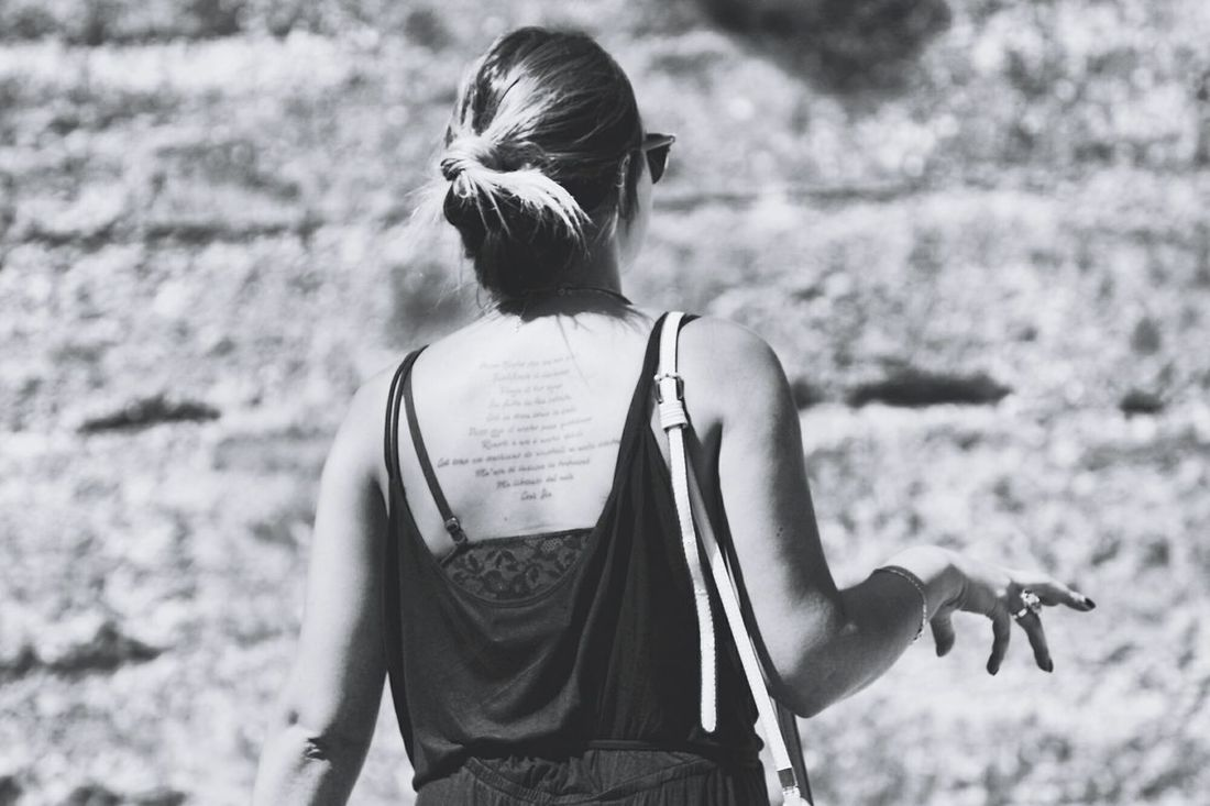 A Tatouage Tattoo on the Back Of a Woman In The Italian Village Of Manarola, In Italy Italy Woman Portrait First Eyeem Photo People And Places.