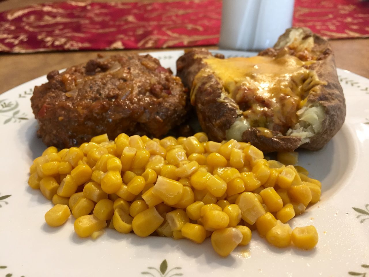 Hamburger Steak and baked potato covered with chili. Abundance Baked Potato Cheese Chili  Close-up Corn Food Freshness Hamburger Hamburger Steak Healthy Eating Indulgence Meal Milk No People Organic Potato Potato Ready-to-eat Selective Focus Serving Size Still Life Sweetcorn