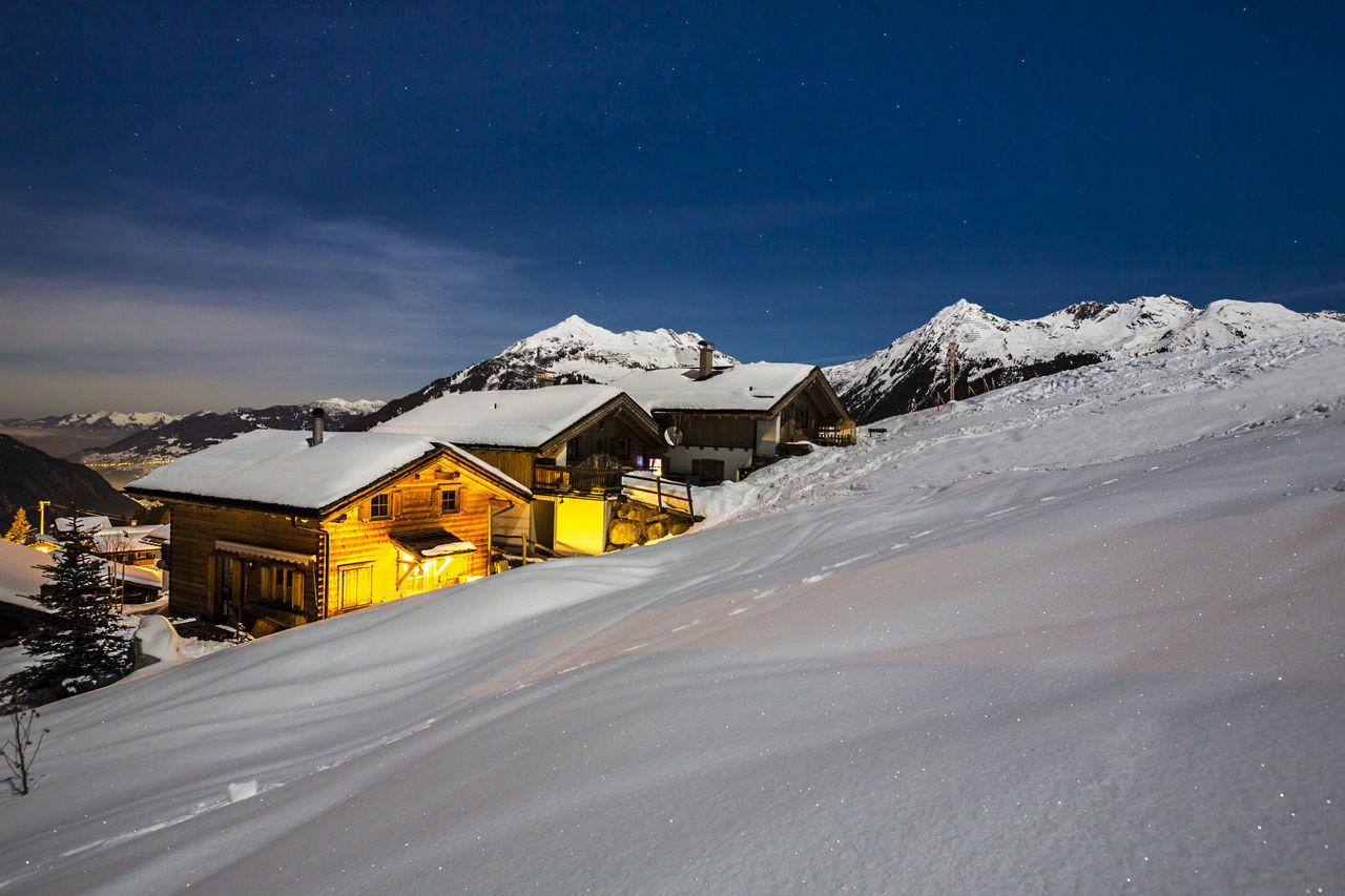 Ski resort at night Chalet Dawn Epic Holidays Hotel Hut Montafon Mountain Mountain Range Nature Night Powder Resort Romantic Ski Skiing Slope Snow Switzerland Tirol  Traditional Travel Vorarlberg  Winter Wooden