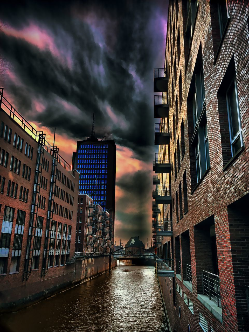 architecture, building exterior, built structure, cloud - sky, sky, no people, sunset, outdoors, river, low angle view, water, day, city, nature