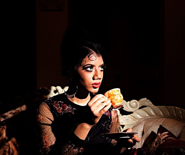 Looking up Food One Person Eating Sitting Beauty Night Holding Indoors  Fashion