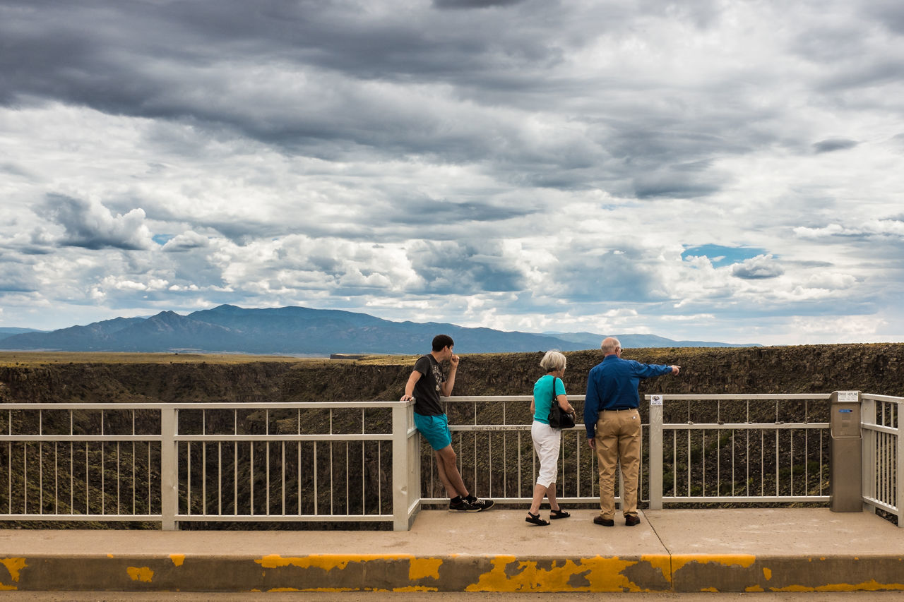 Look! Adult Adults Only Bridge - Man Made Structure Cloud - Sky Day Gorge Mountain Outdoors People Railing Rio Grande Gorge Rocky Mountains Río Grande Sky Street Streetphotography Togetherness Young Adult