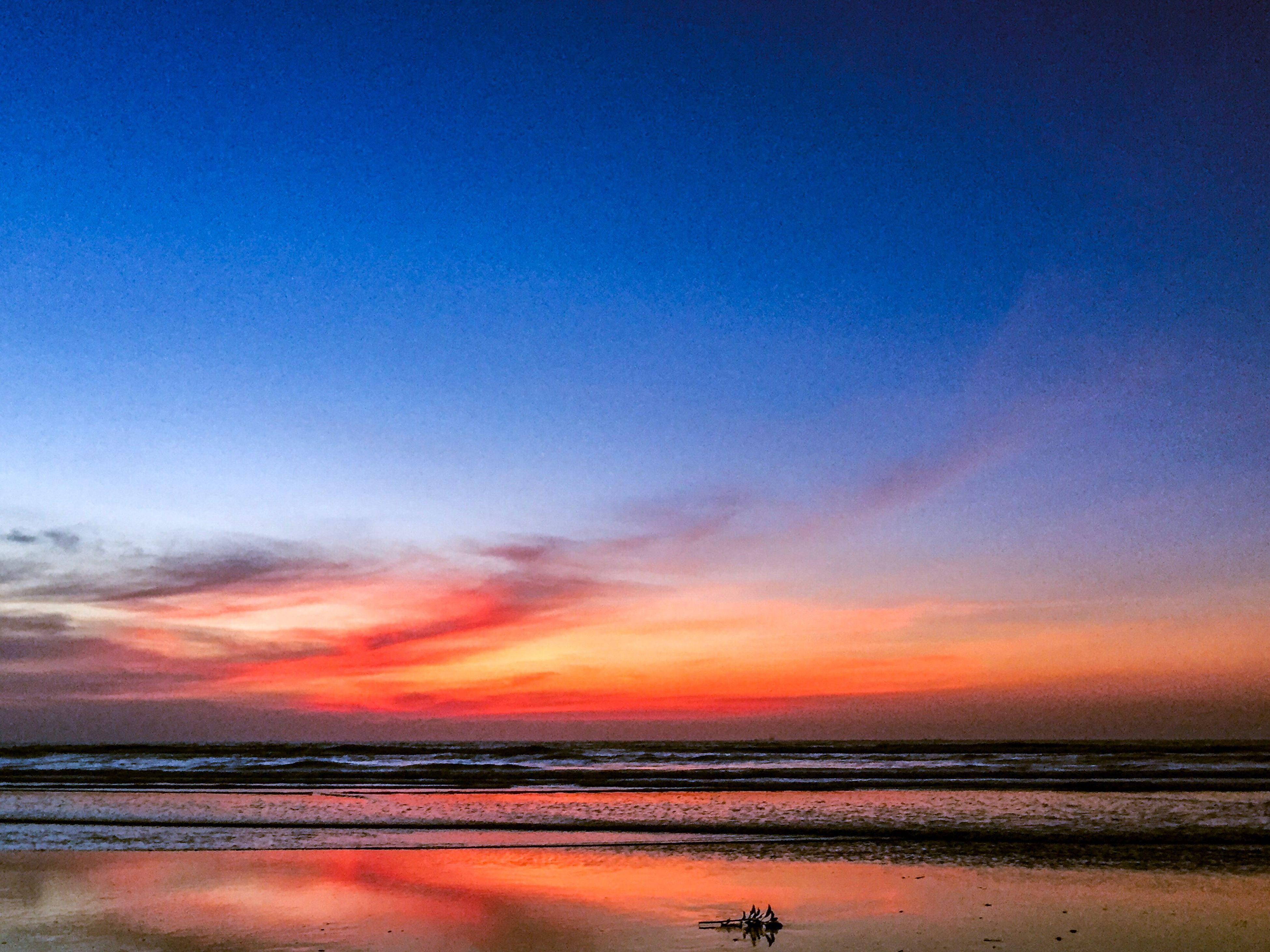 water, sunset, reflection, sea, beauty in nature, tranquility, blue, sky, nature, scenics, tranquil scene, beach, idyllic, no people, outdoors, silhouette, horizon over water, day