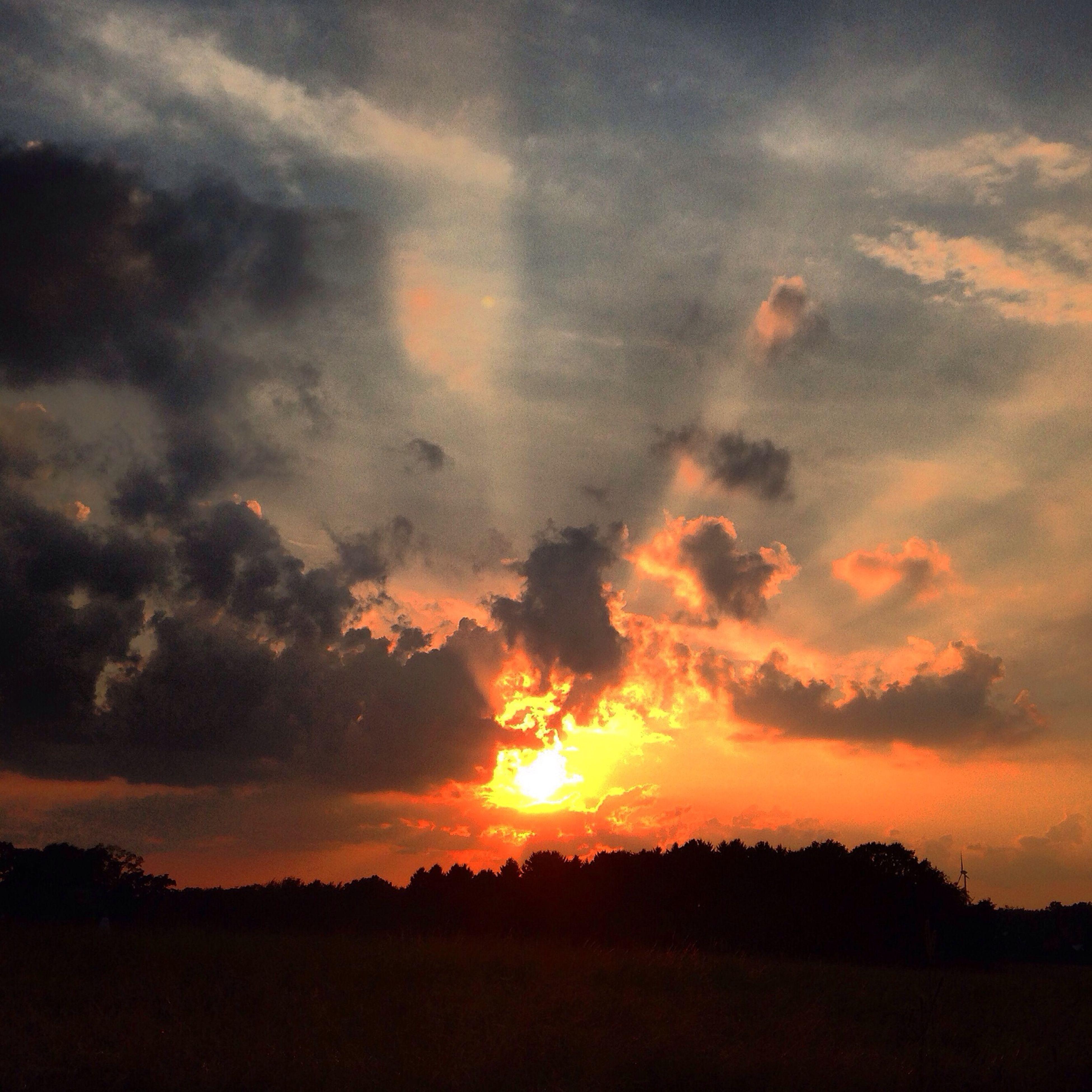 sunset, silhouette, sky, tranquil scene, scenics, beauty in nature, tranquility, landscape, cloud - sky, orange color, nature, idyllic, dramatic sky, sun, cloud, field, cloudy, outdoors, sunlight, moody sky