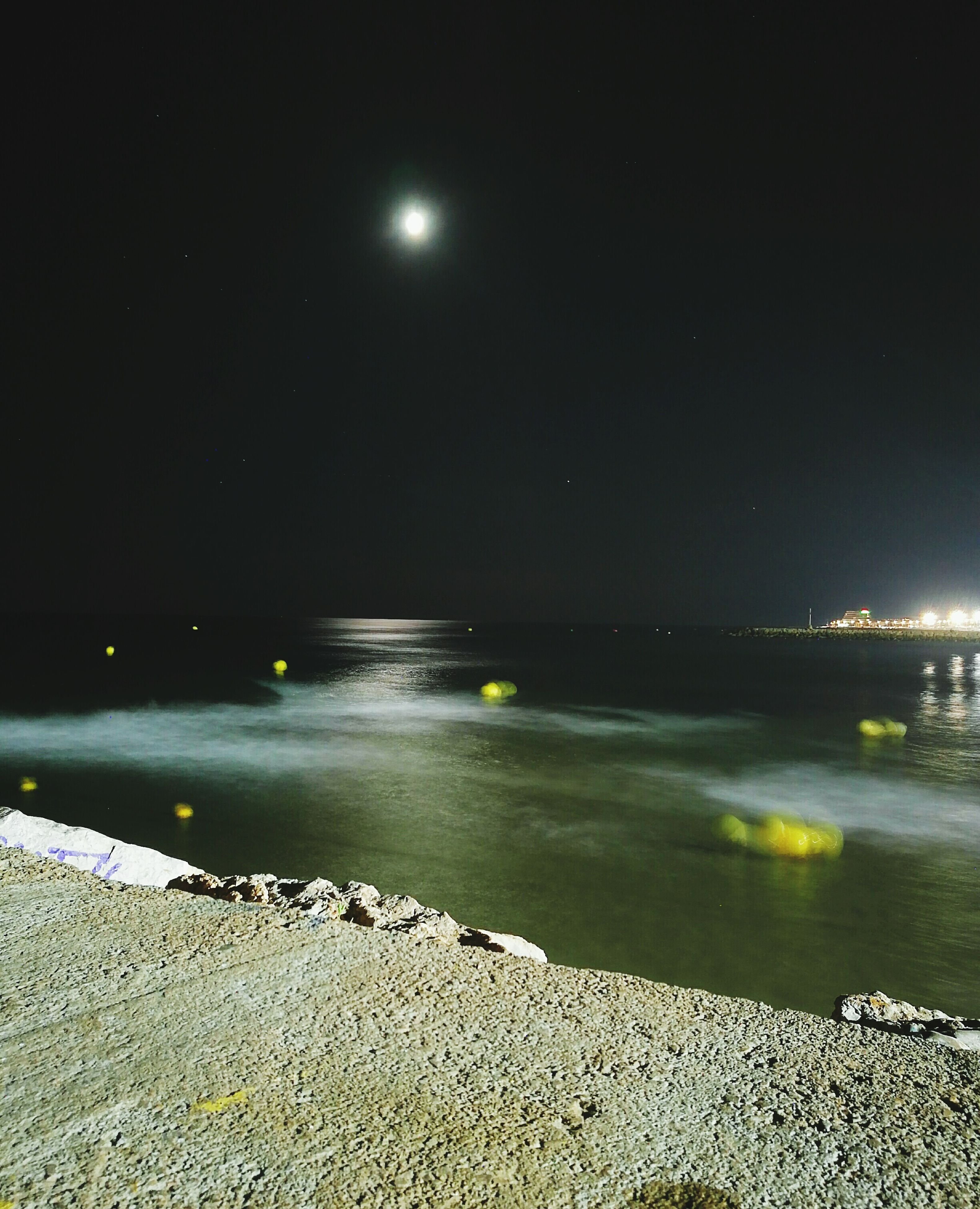 night, beach, water, tranquil scene, scenics, sand, sea, tranquility, shore, beauty in nature, idyllic, moon, summer, majestic, nature, illuminated, travel destinations, sky, vacations, tourism, seascape, outdoors, remote, tide, non-urban scene, coastline