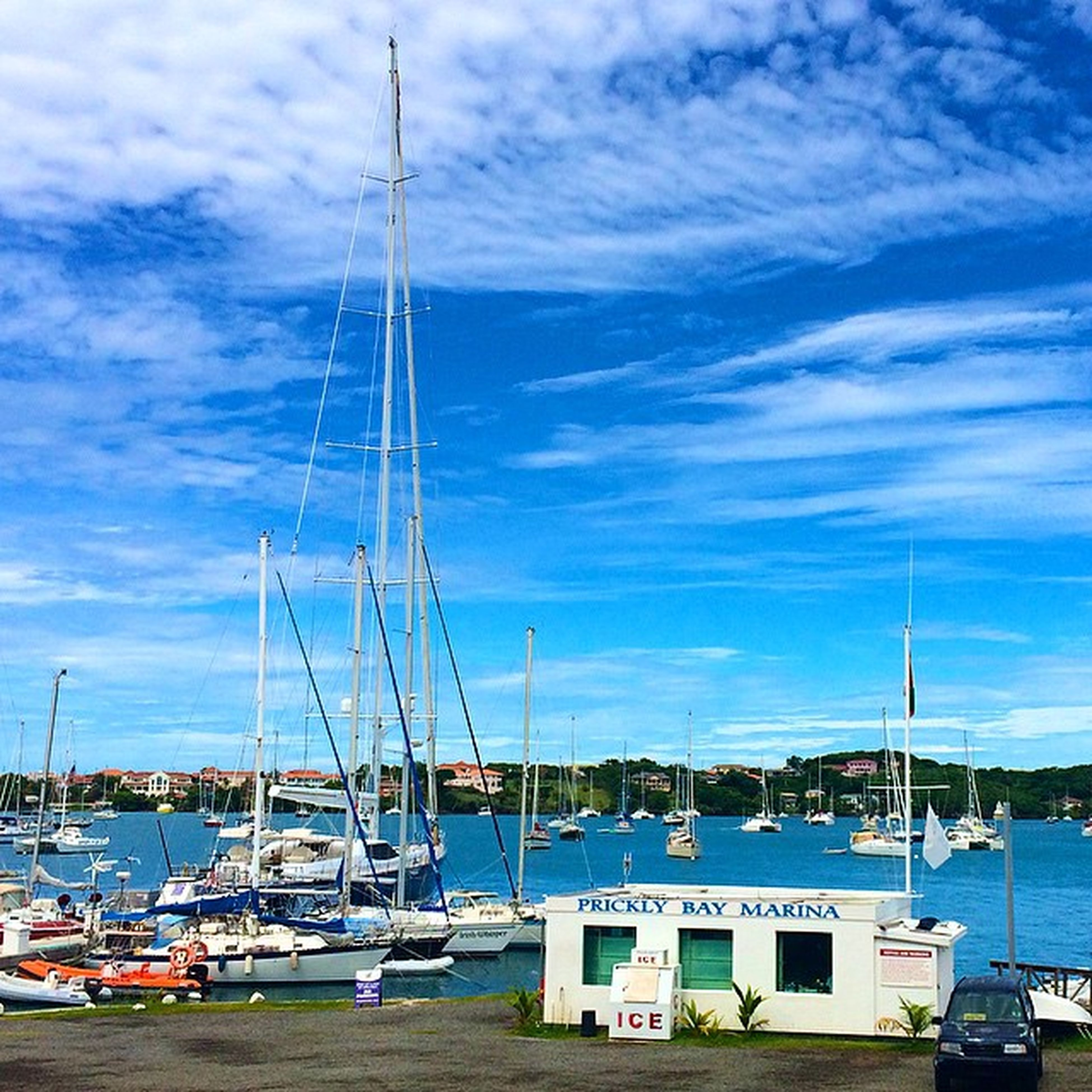 nautical vessel, transportation, moored, mode of transport, sky, mast, boat, water, harbor, cloud - sky, sailboat, sea, cloud, blue, cloudy, day, travel, nature, outdoors, no people