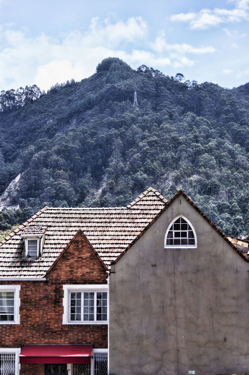 mountain, building exterior, built structure, architecture, house, sky, no people, day, outdoors, cloud - sky, snow, scenics, nature, beauty in nature, tiled roof