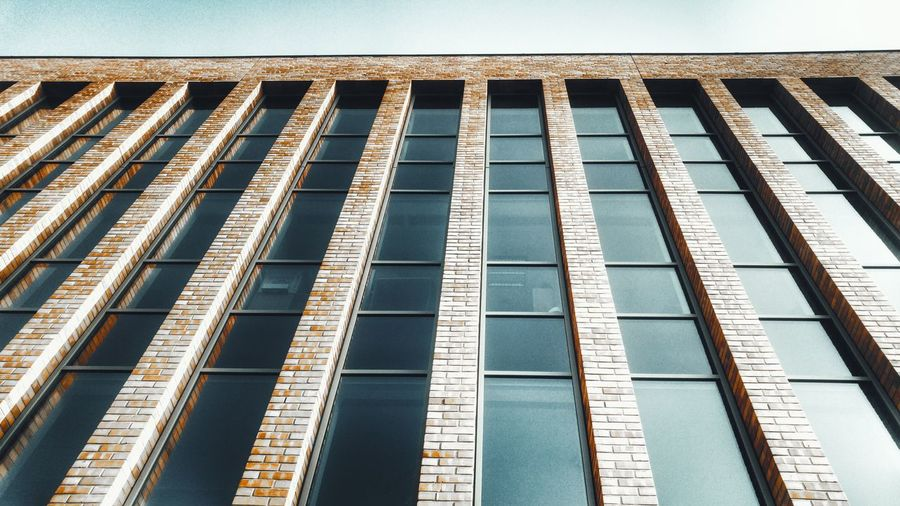 Outdoors Day Pattern Built Structure No People Full Frame Architecture Low Angle View Backgrounds Close-up Sky Szczecin Spacer Po Szczecinie Walking Around Morning Walk City Architecture Brick Red Brick Brick Wall Brick Building Windows Modern Modern Architecture Modern Building Minimalist Architecture