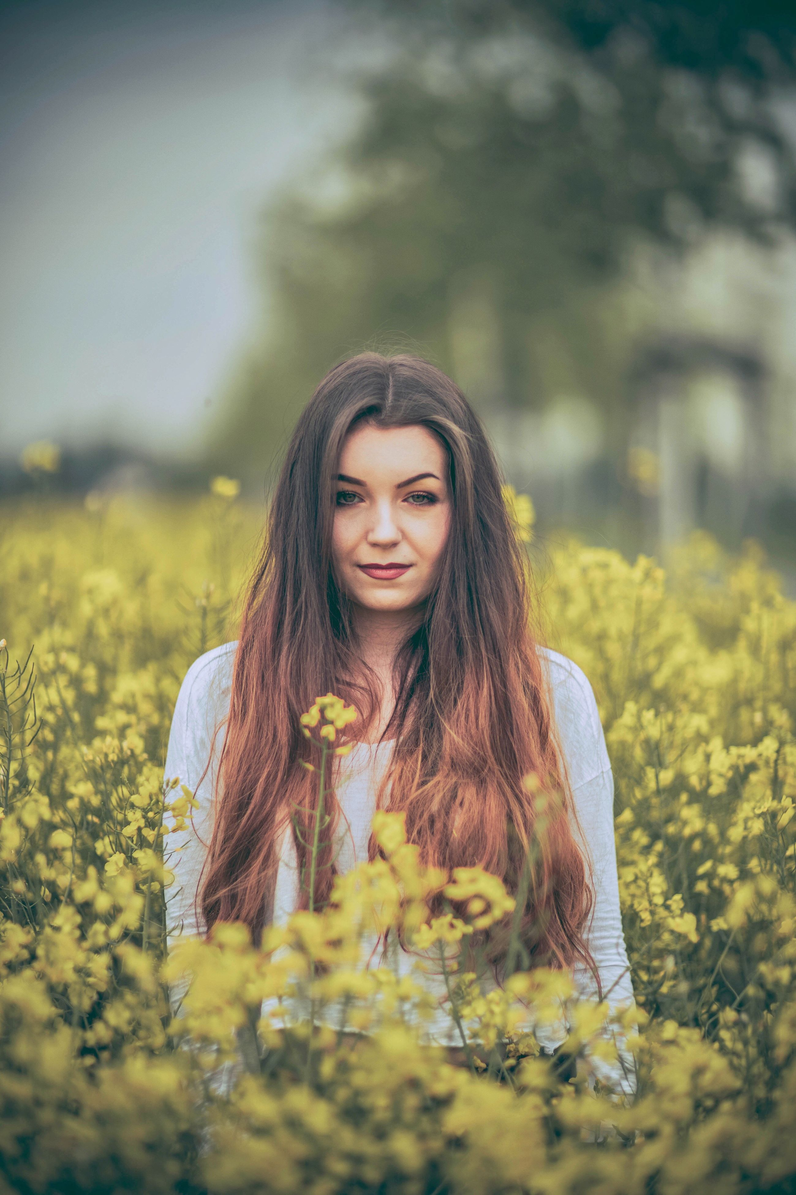 flower, young adult, young women, yellow, nature, long hair, beautiful woman, one person, front view, field, beauty in nature, real people, plant, lifestyles, beauty, leisure activity, focus on foreground, outdoors, women, oilseed rape, springtime, day, growth, beautiful people, fragility, portrait, one young woman only, freshness, adult, people