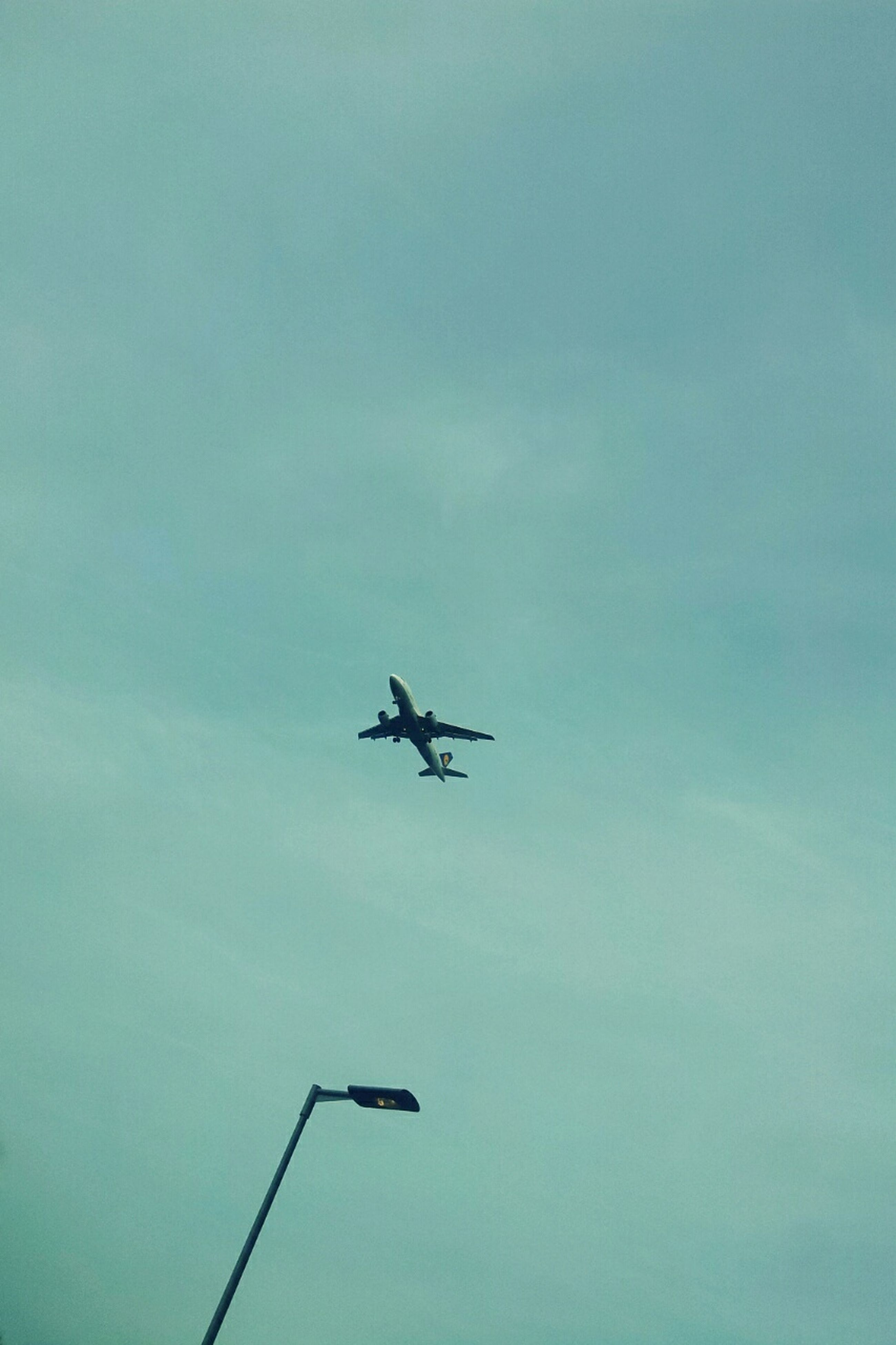 transportation, airplane, mode of transport, air vehicle, low angle view, flying, mid-air, sky, on the move, journey, travel, blue, copy space, public transportation, day, outdoors, commercial airplane, cloud - sky, helicopter, silhouette