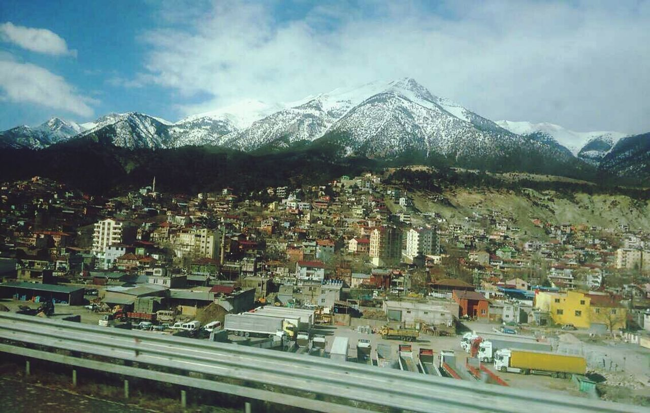 mountain, mountain range, architecture, snow, building exterior, snowcapped mountain, built structure, no people, scenics, day, outdoors, town, cityscape, sky, nature, travel destinations, cold temperature, landscape, beauty in nature, city, range