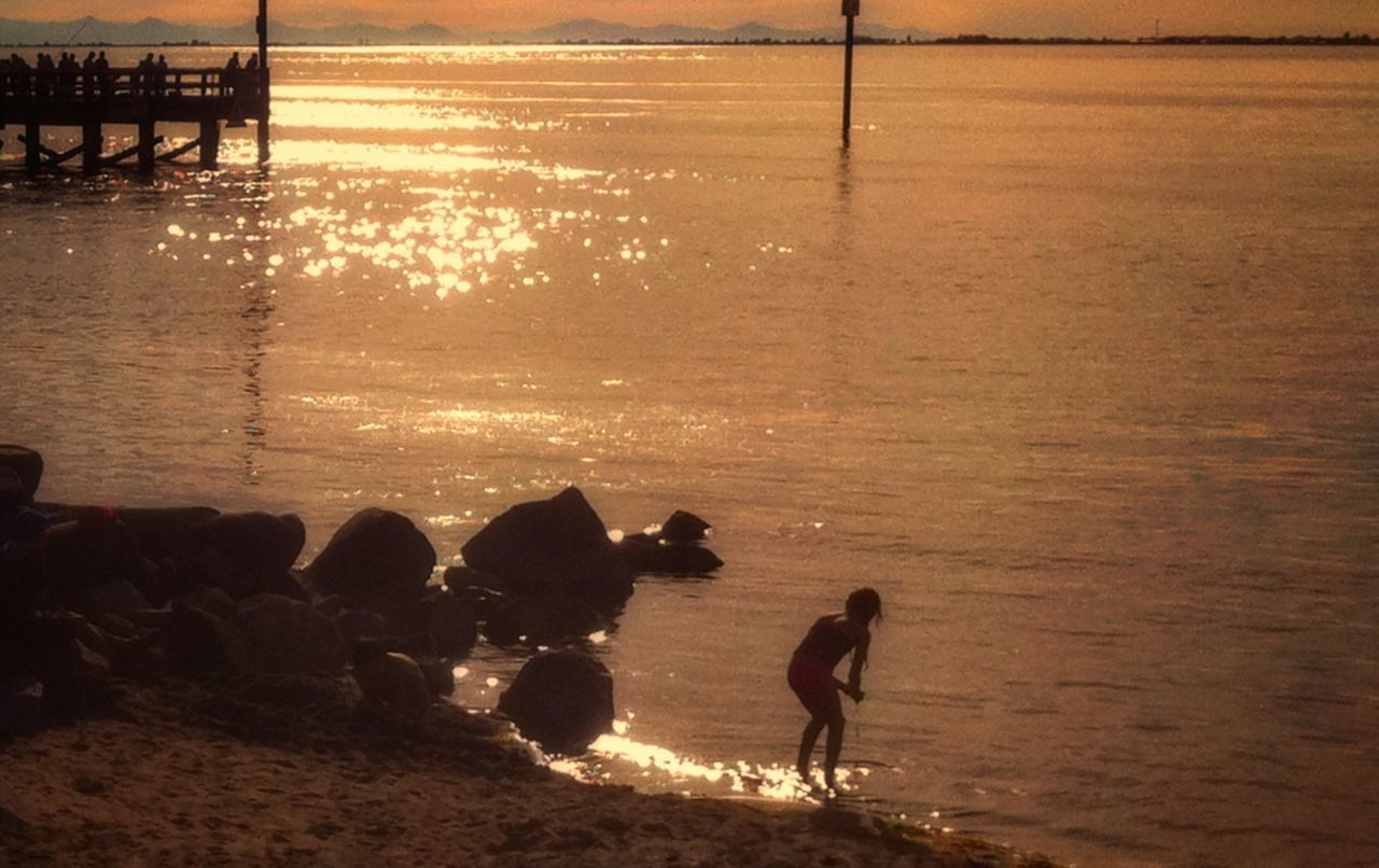 Water Sunset Silhouette Real People Nature Outdoors Sea Beach Beauty In Nature Men Day People The Way Forward Dramatic Sky Tranquility Reflection Scenics Illuminated Tranquil Scene Lifestyles Silhouette Shadow Horizon Over Water Beauty In Nature Landscape