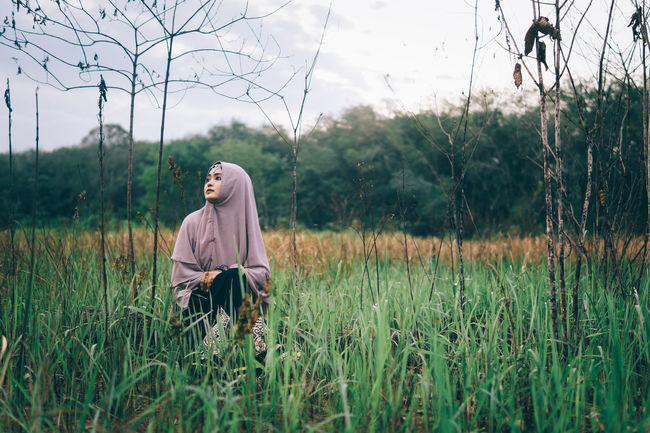 Grass Field Side View Landscape Grassy Tranquil Scene Countryside Nature Rural Scene Tranquility Growth Day Young Adult Non-urban Scene Person People Sitting Outdoors Alone Beautiful Girl Mood Portrait Of A Woman Hijab Young Women