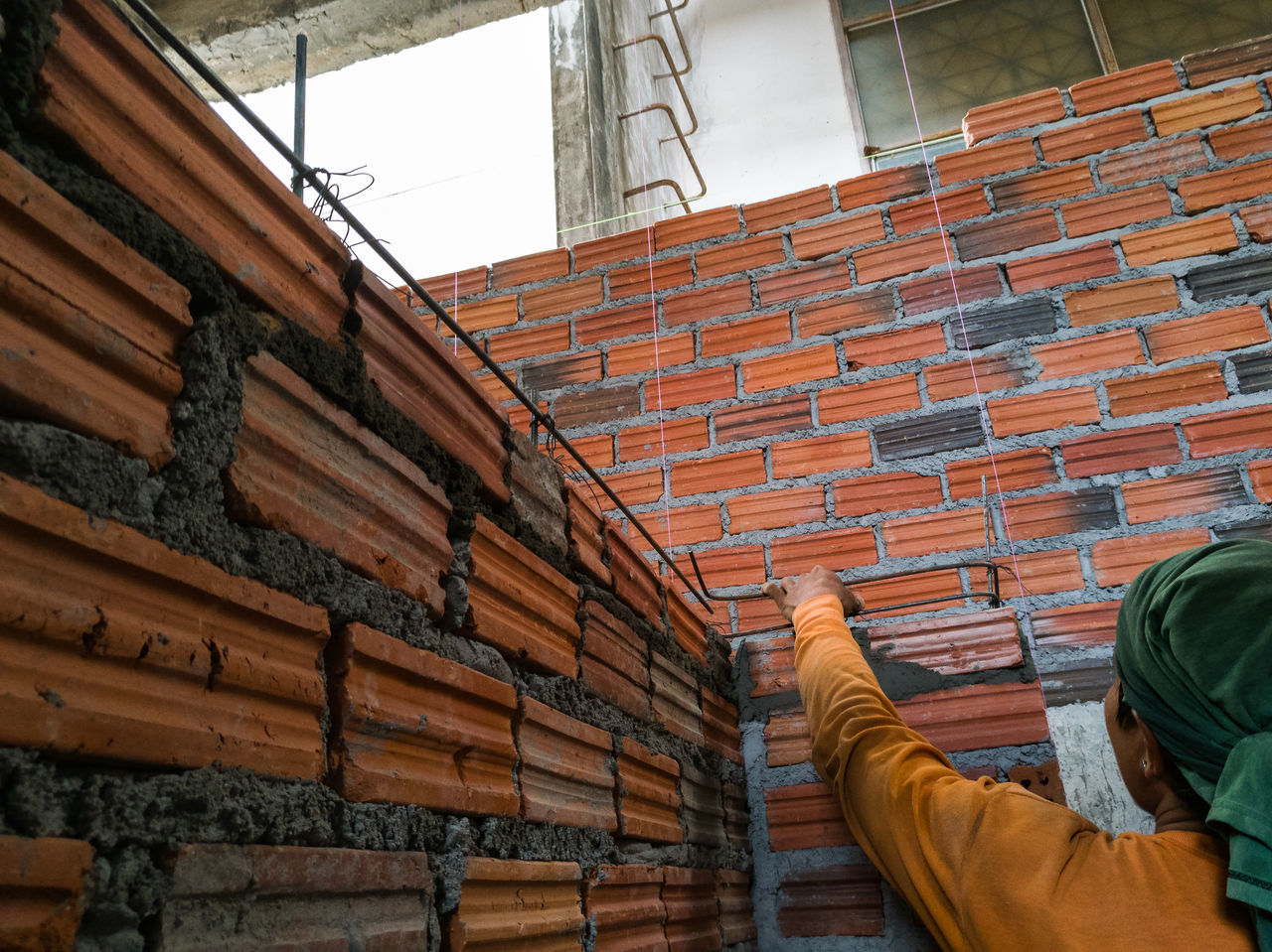 Installation of steel in the lintel of the wall construction with brick red, not gloss surface. Build Builder Building Construction Site Construction Work Lintel Redbricks Redbrickw Steelbar  Wall