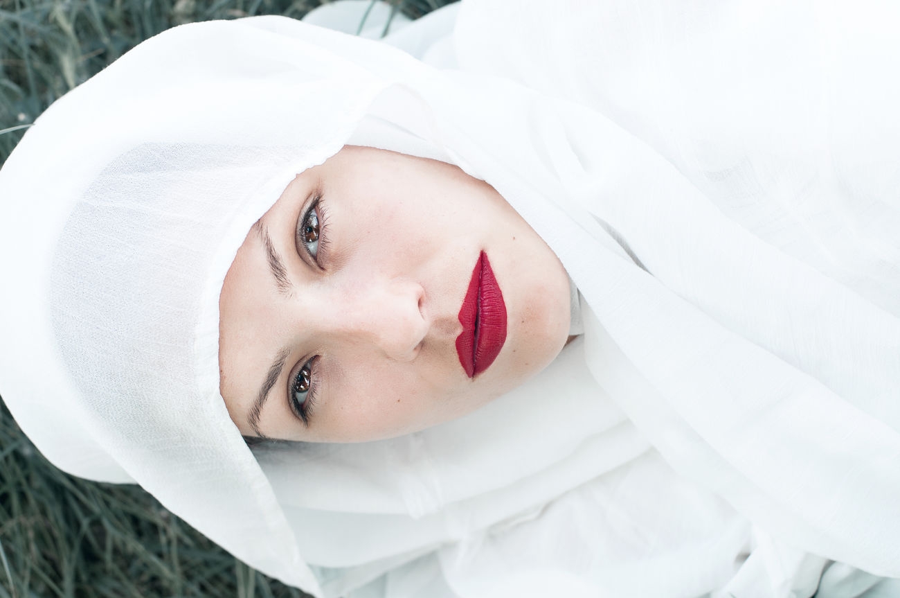 I'll never be a saint. Beautiful Woman Eye4photography  EyeEm Best Shots EyeEm Gallery High Angle View Looking At Camera Outdoors Portrait Real People Red Lipstick The Portraitist - 2017 EyeEm Awards White Color Young Women