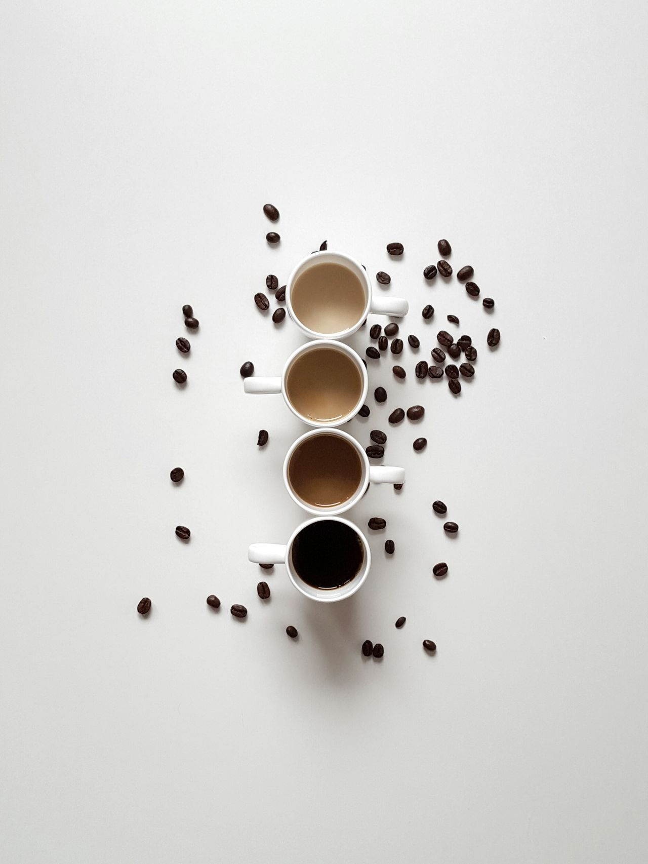 Different shades of coffee Coffee Kickstart Liquid Lunch Fresh Products Caffeine Milk Cups Porcelain  White Background Different Shades Of Brown Coffee Break Delicious Smell Hot Drink Good Morning Coffee Beans Minimalism Barista Energy Boost Espresso Coffee Breakfast Drink Tasty Food