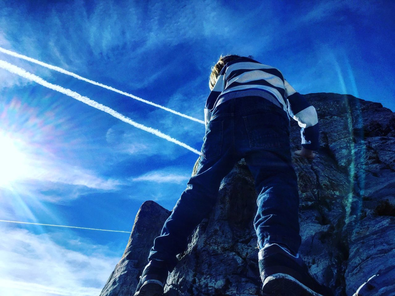 low angle view, sky, blue, day, outdoors, cloud - sky, nature, sunlight, no people, vapor trail, beauty in nature
