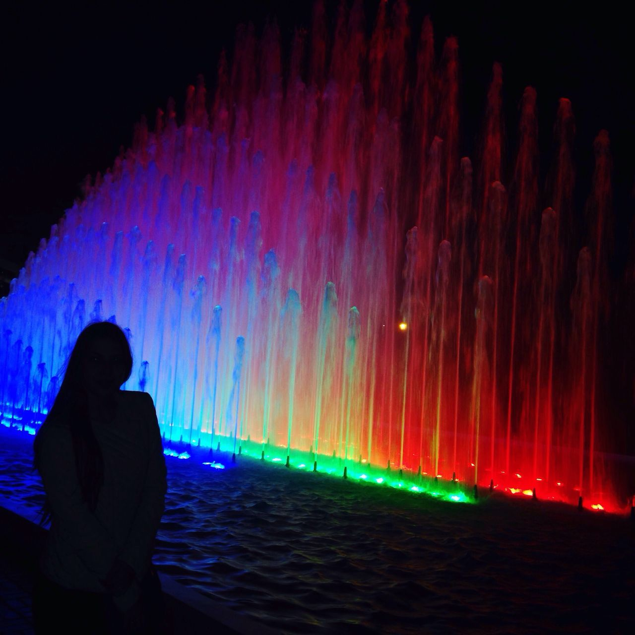 night, illuminated, multi colored, colorful, real people, motion, water, long exposure, one person, women, leisure activity, lifestyles, indoors, men, nature, sky, people