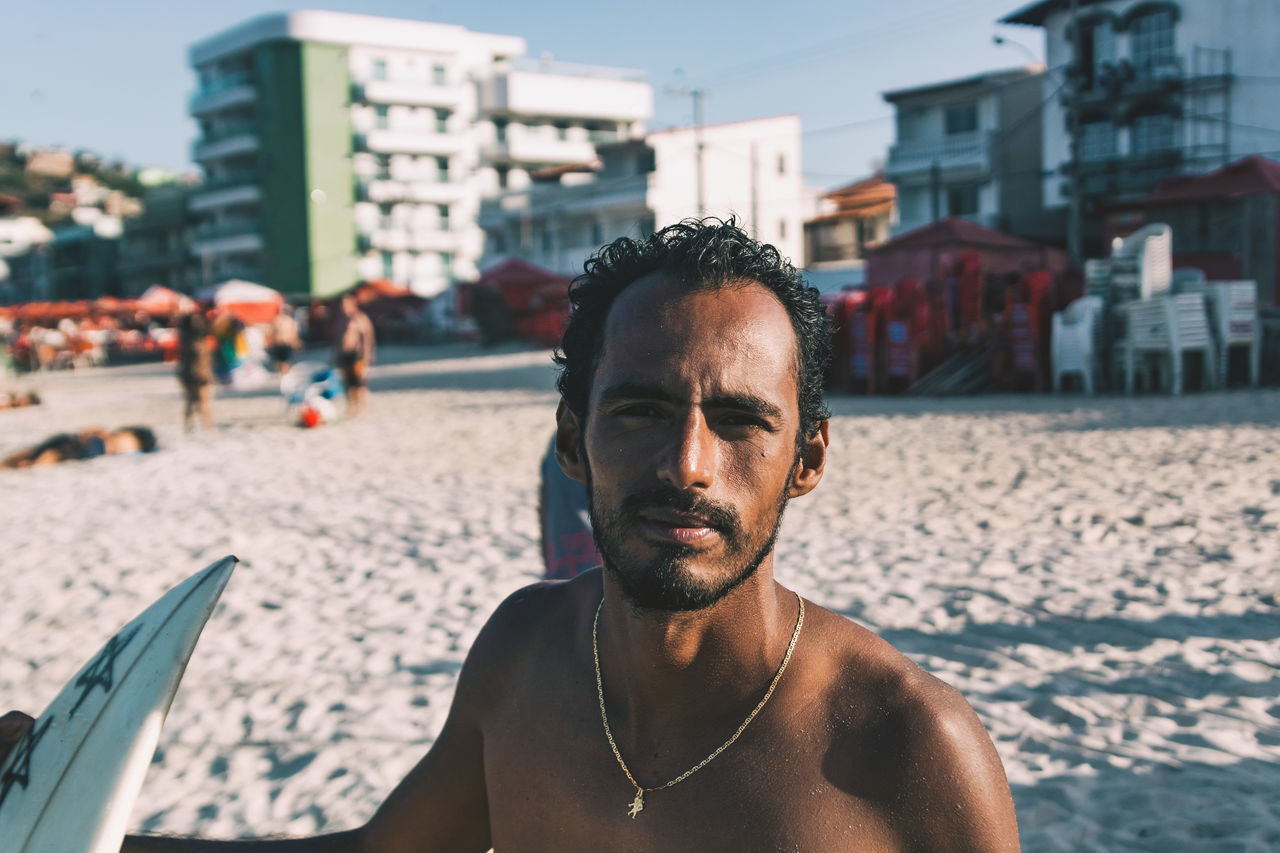 A portrait of a guy I met on the beach in Arraial. He kindly borrowed me his surfboard. It was my 2nd attempt at surfing. The board was small and the waves were even smaller. But I had a great talk with Douglas - although he didn't have English and I couldn't speak Portuguese! :D The Portraitist - 2017 EyeEm Awards sea water outdoors sky Tranquility tranquil scene ocean leisure activity real people Standing portrait of a friend portrait beard Surf surfing sport men Man board Looking At Camera bokeh one person focus on foreground walking Fresh on Market 2017