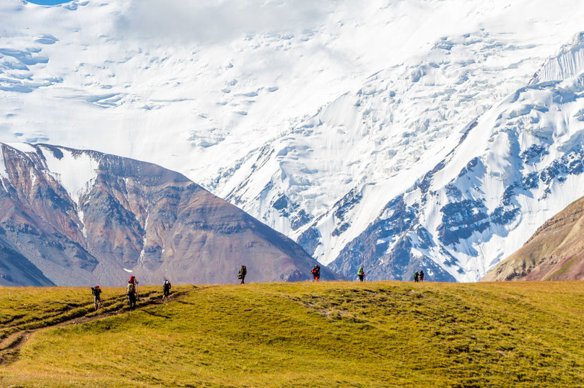 Kyrgyzstan Pamir Mountains Adventure Beauty In Nature Cold Temperature Day Exploration Hiking Landscape Leisure Activity Lifestyles Mountain Mountain Range Nature Outdoors Pamir Real People Scenics Sky Snow Snowcapped Mountain Togetherness Tranquil Scene Tranquility Travel Destinations Vacations Walking Winter
