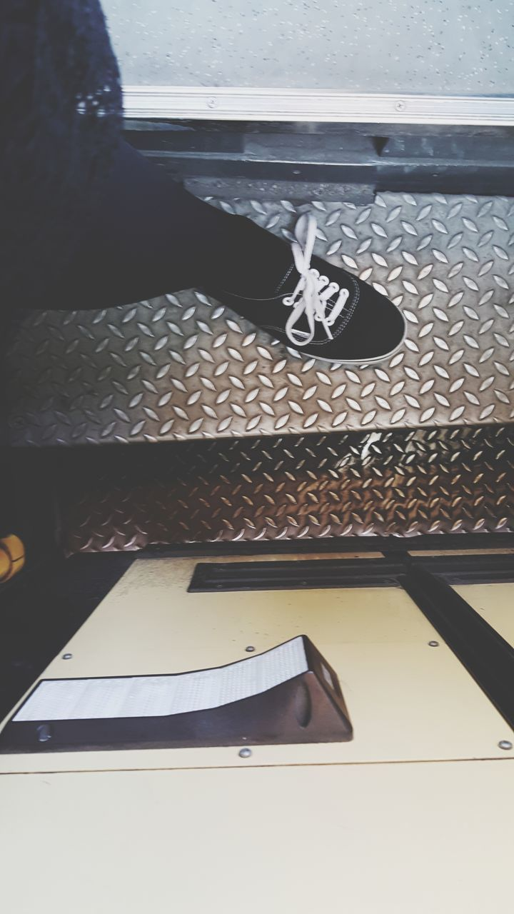 low section, shoe, human leg, indoors, high angle view, real people, one person, day, close-up