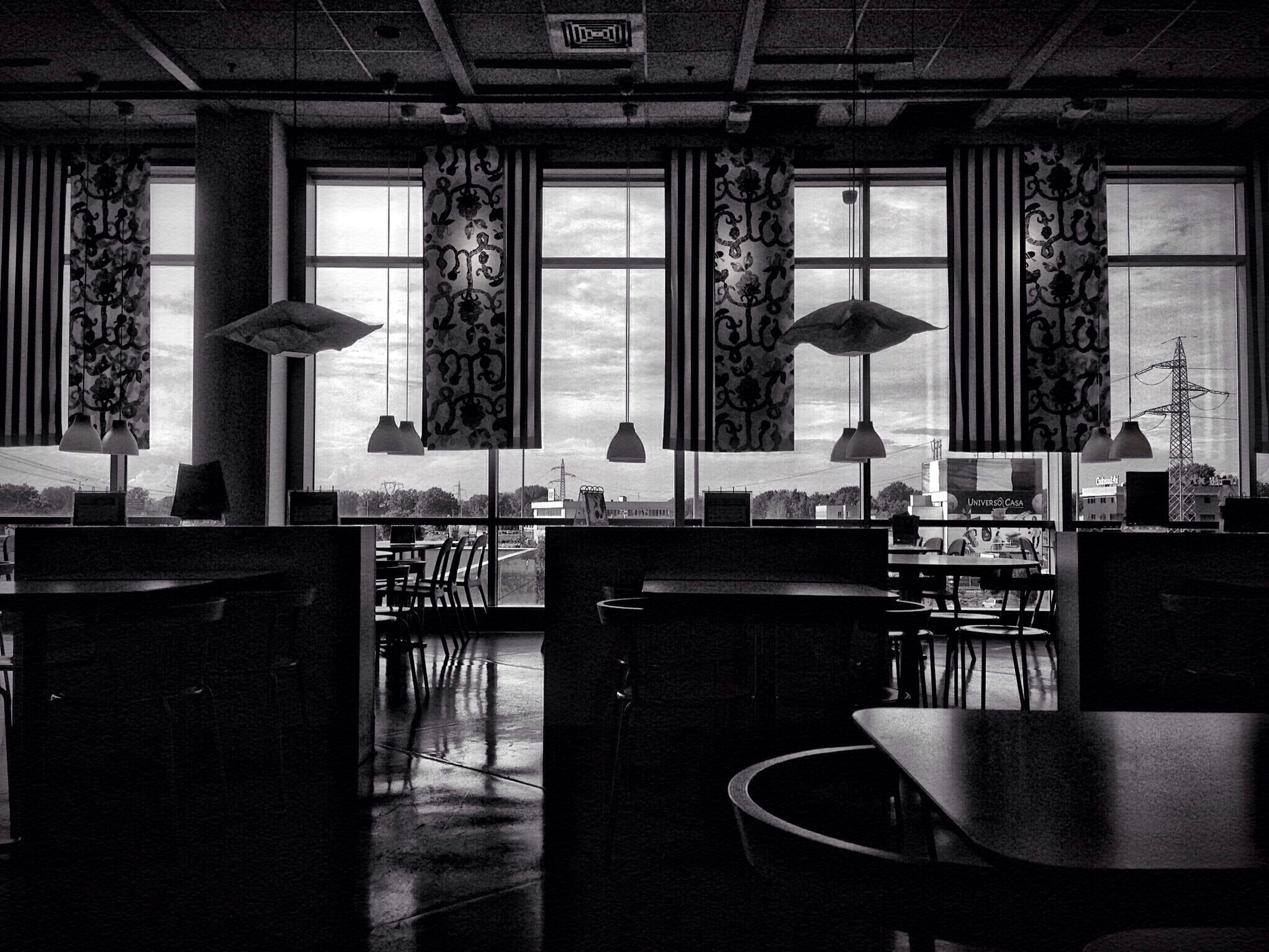 indoors, chair, table, absence, empty, window, home interior, architecture, old-fashioned, interior, no people, furniture, built structure, lighting equipment, retro styled, still life, restaurant, shelf, wood - material, technology