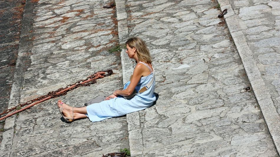 Long Goodbye One Person Full Length Day High Angle View Casual Clothing People Outdoors Adults Only Adult Sitting Real People Women Only Women