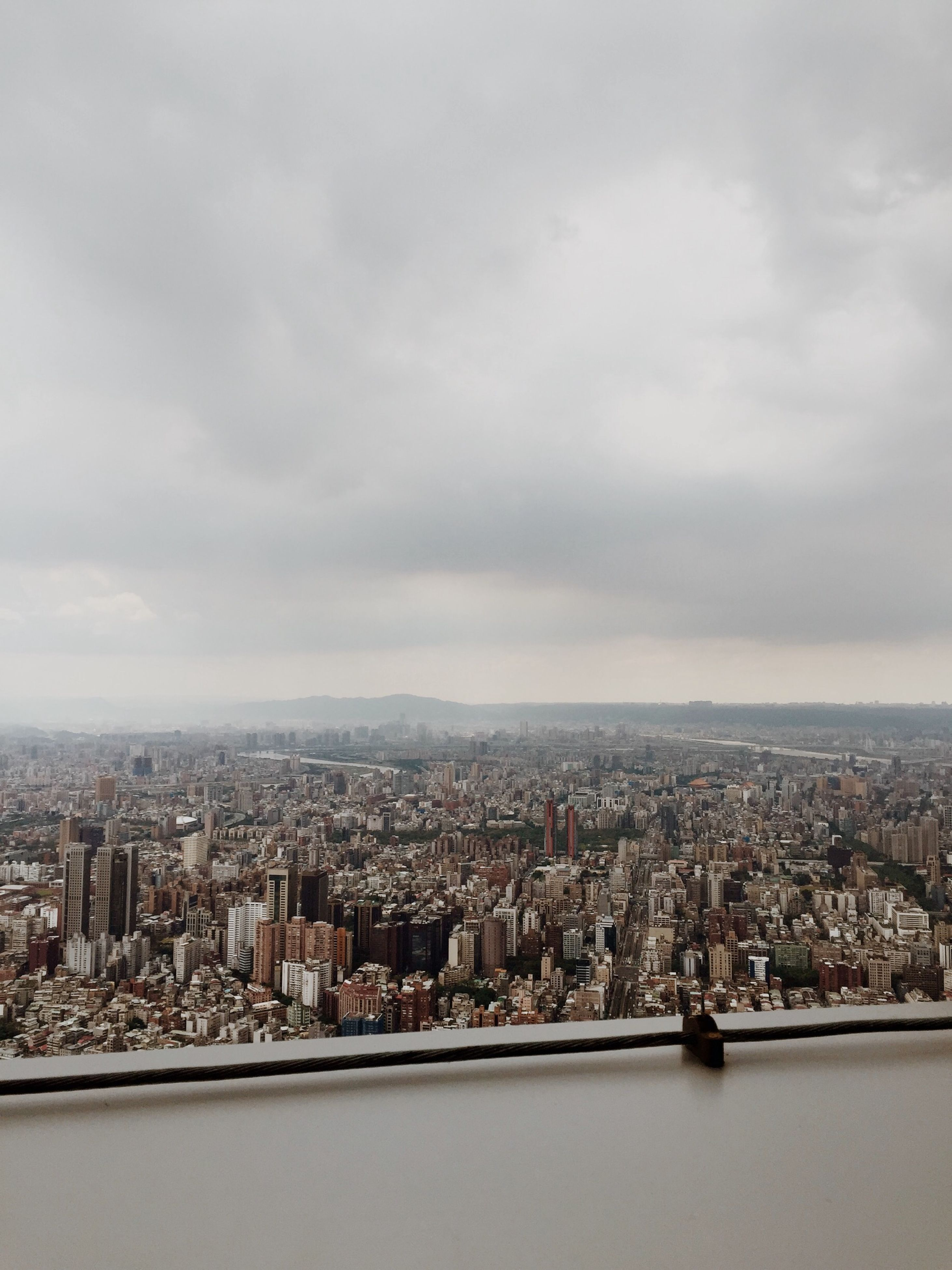 cityscape, city, building exterior, architecture, sky, built structure, crowded, cloud - sky, residential district, high angle view, water, cloudy, cloud, river, residential building, sea, skyscraper, residential structure, city life, no people