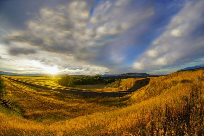 Perspectives On Nature Scenics Tranquil Scene Landscape Cloud - Sky Nature Grass Beauty In Nature Tranquility Field Sky Dramatic Sky Atmospheric Mood No People Idyllic Rural Scene Sunset Meadow Mountain Outdoors Green Color