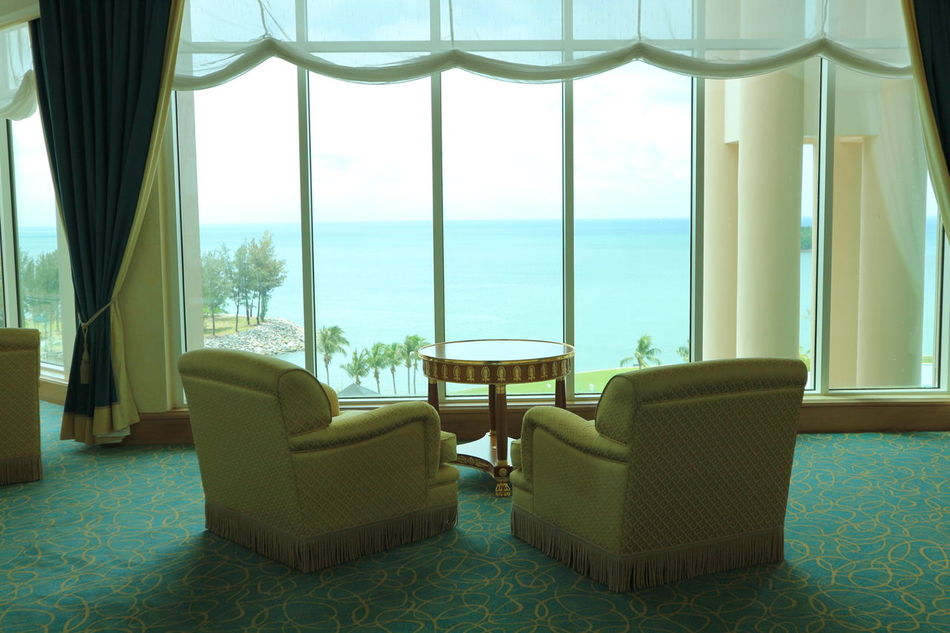 Sea Relaxation Vacations Luxury Window Armchair Luxury Hotel Tourism Furniture Travel Destinations Brunei Darussalam EyeEmNewHere EmpireHotelBrunei Tranquility Palm Tree Water Blue Scenics Cloud - Sky View From The Window... The Secret Spaces