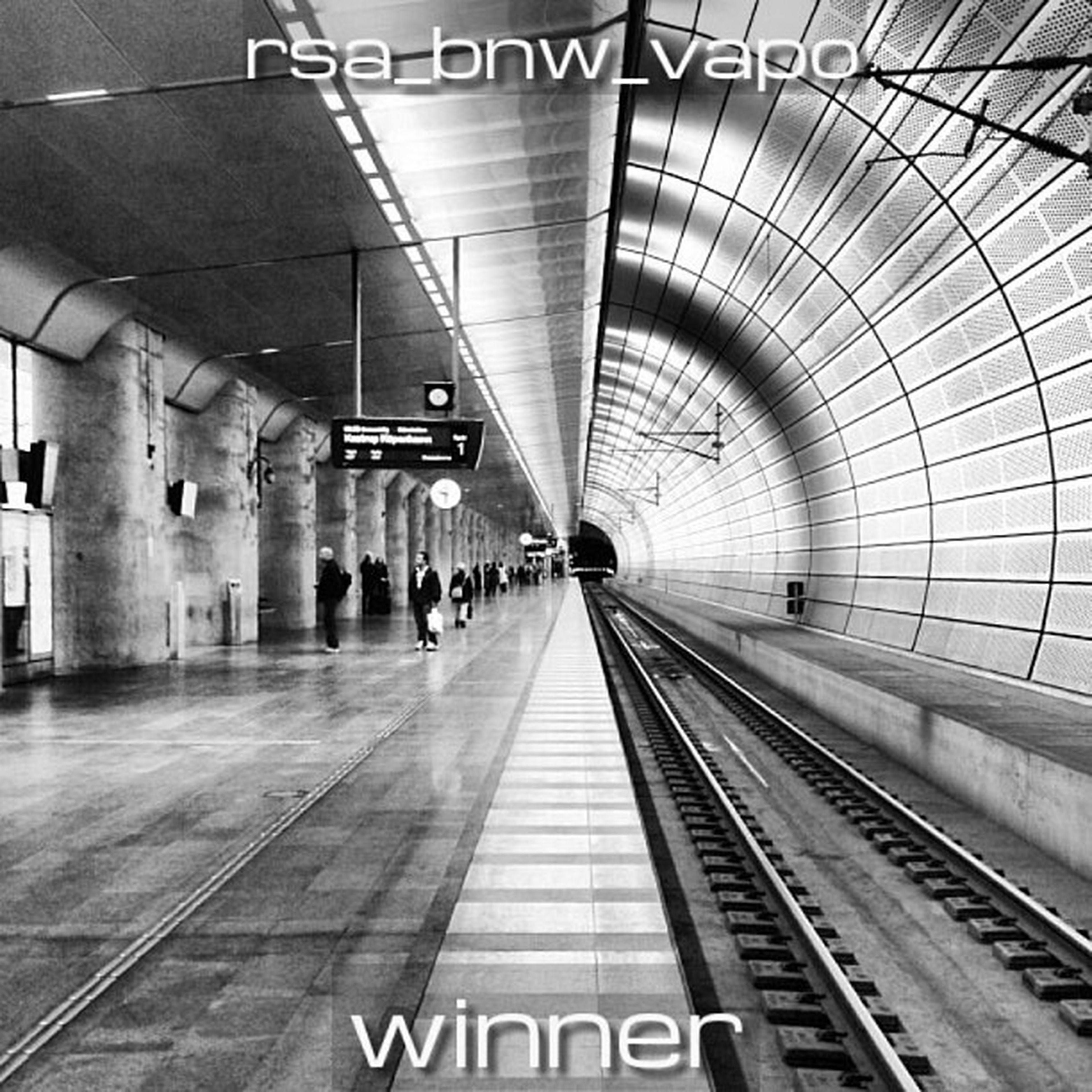 railroad station, rail transportation, railroad station platform, railroad track, transportation, public transportation, indoors, subway station, architecture, built structure, the way forward, subway, transportation building - type of building, ceiling, diminishing perspective, station, train - vehicle, travel, illuminated, text