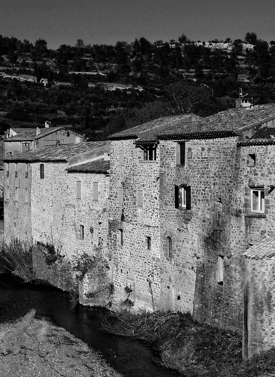 Village Architecture Built Structure Building Exterior Day History Outdoors No People Sky Medieval Ancient Civilization Lagrasse Aude Occitanie River Bridge Old House