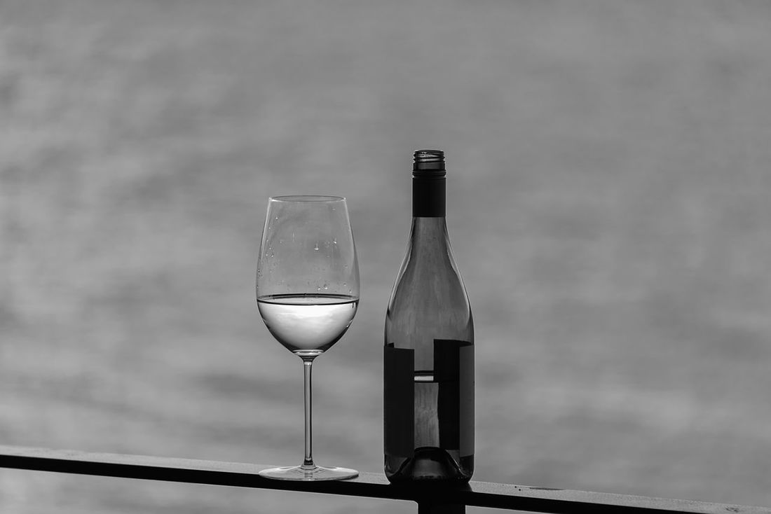 White wine glass with bottle outside Al Fresco Alcohol Bottle Deck Drinking HERO No People Sailing Seaside Shore Stemware White Wine