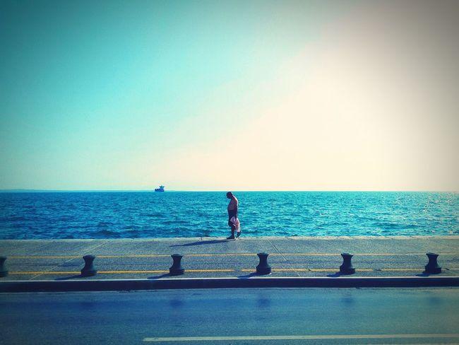 Taking Photos / Snapshots while walking along the quai! : 2 on km 0, 2 Walk This Way Heat man Walking Alone... Oben Ohne Empty Street without cars Urban 3 Filter Yellow N White Stripes Blue