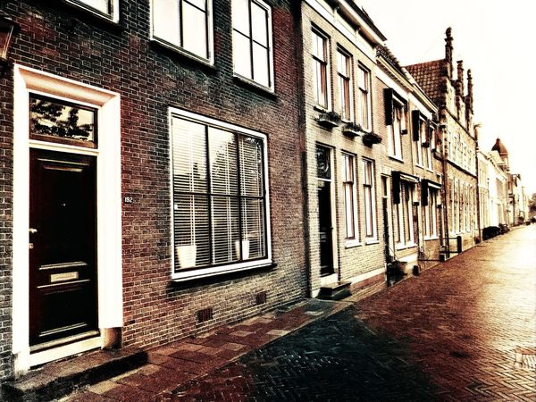 Alkmaar, Netherlands - August 15th 2017: illustrative Editorial from street with old buildings Architecture Building Exterior Built Structure No People Alkmaar Netherlands North Holland Illustrative Editorial Illustration Brick Building Dutch Europe Façade Historic House Vintage Old Street Tourism Travel Old Town Vintage Style