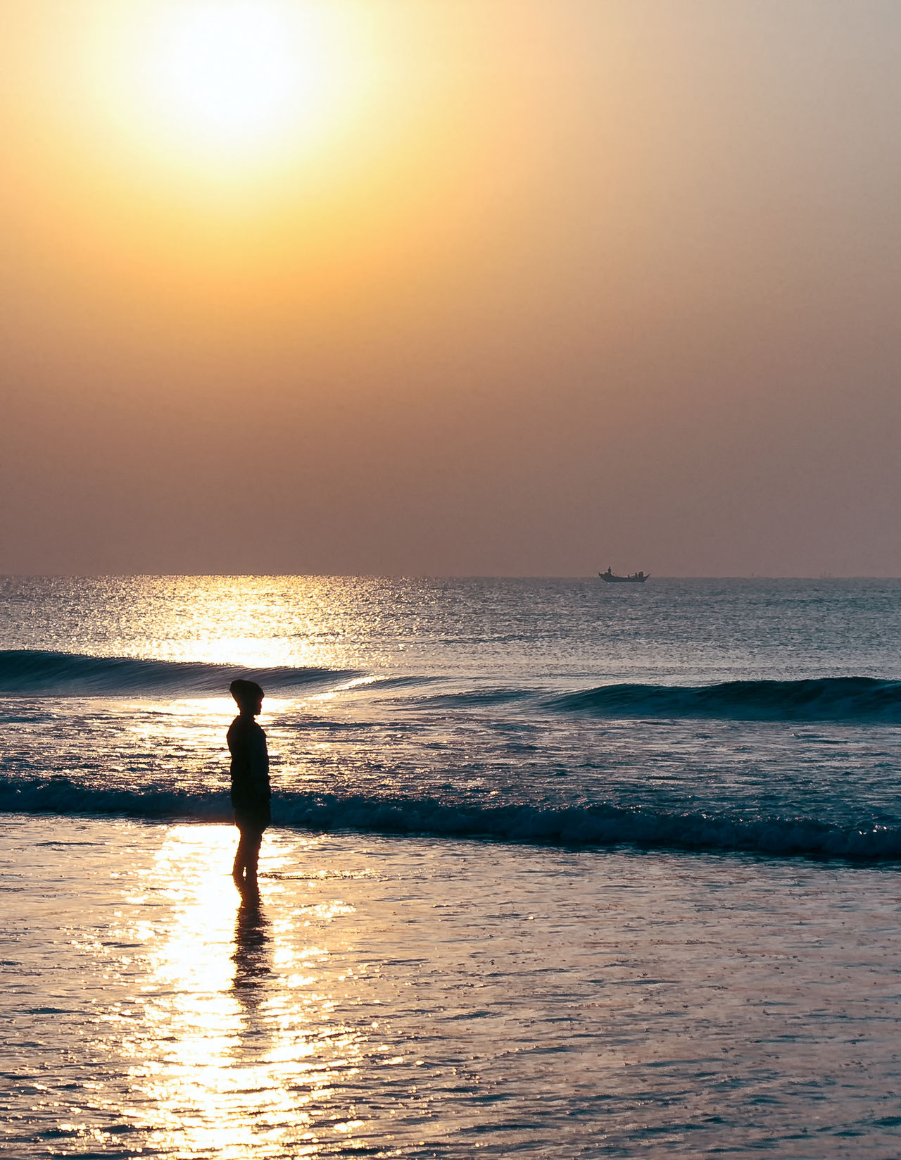 Alone under the sun! Silhouette Sea Water Standing One Person Beach Outdoors Tranquil Scene Scenics Travel Serene Sunlit Nature Beauty In Nature Tranquility Travel Photography Peaceful Miles Away Tranquil Moment Sunrise Colors Sunrise - Dawn Sunrise Dawn Morning
