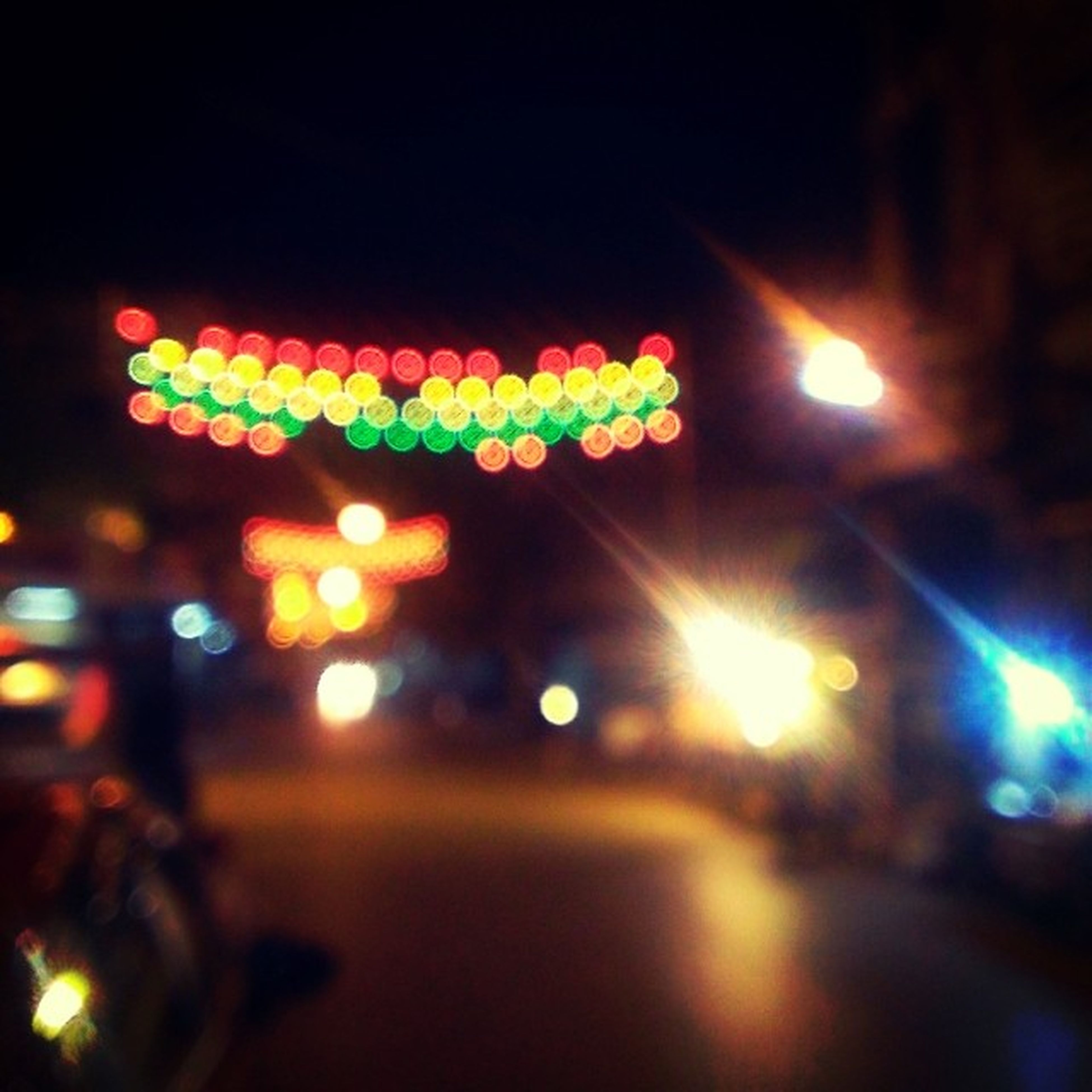 illuminated, night, defocused, multi colored, lighting equipment, lens flare, light - natural phenomenon, glowing, decoration, street, celebration, no people, outdoors, colorful, reflection, street light, light, focus on foreground, city, sky