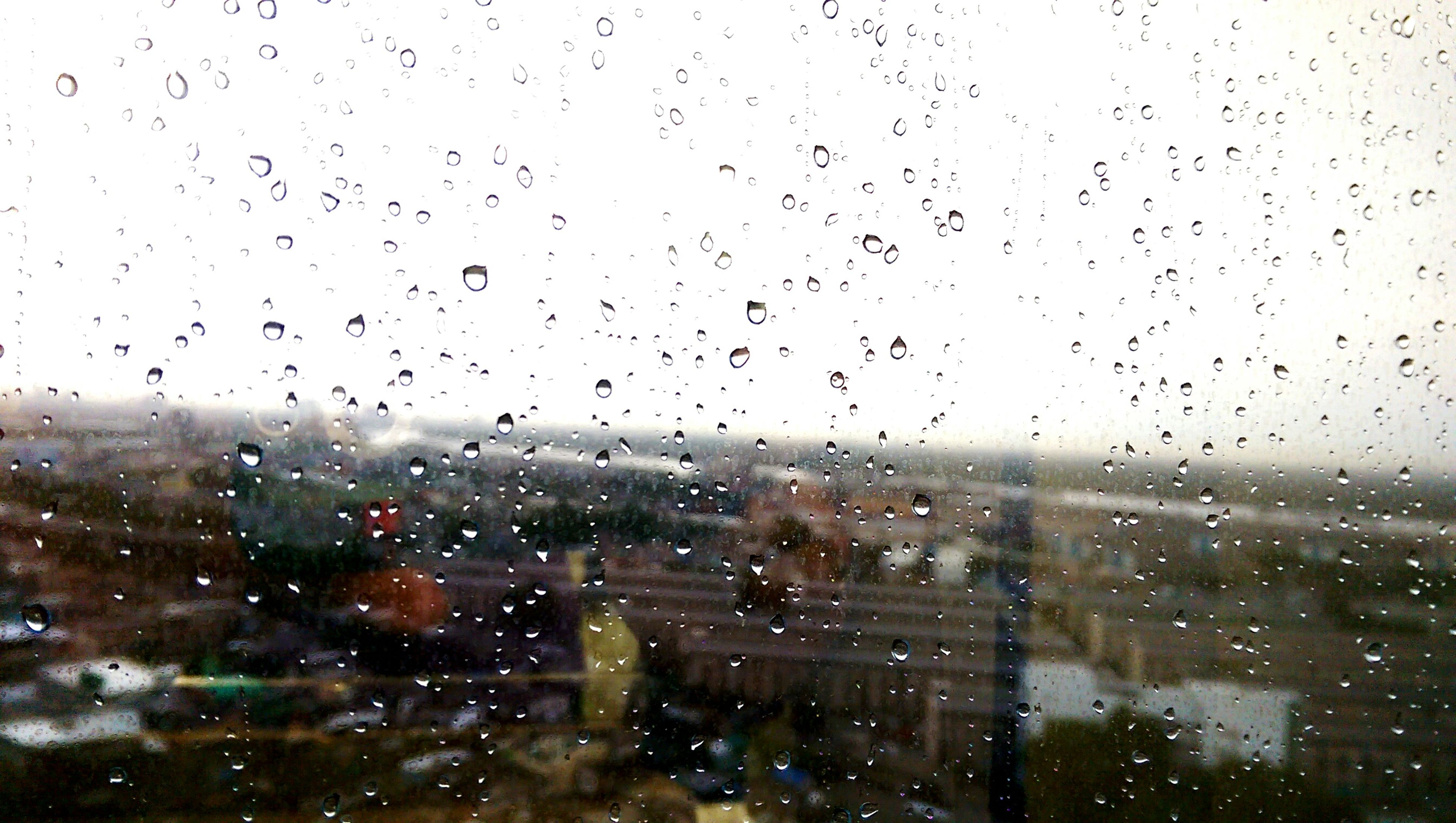 drop, wet, window, rain, indoors, weather, transparent, building exterior, architecture, built structure, city, water, cityscape, glass - material, raindrop, season, sky, focus on foreground, full frame, glass