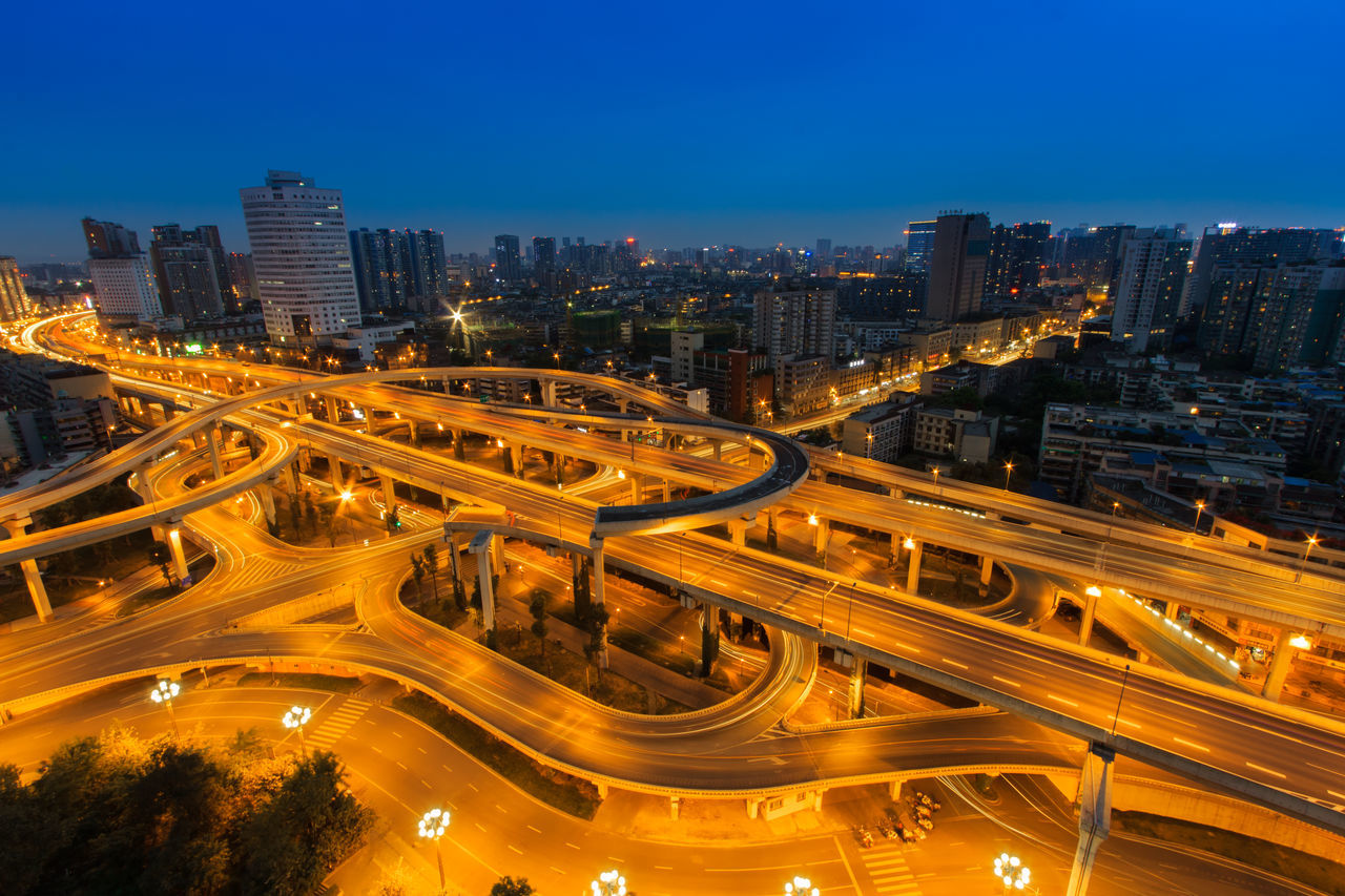 High Angle View Of Illuminated Multiple Lane Highway In City Against Clear Blue Sky At Dusk