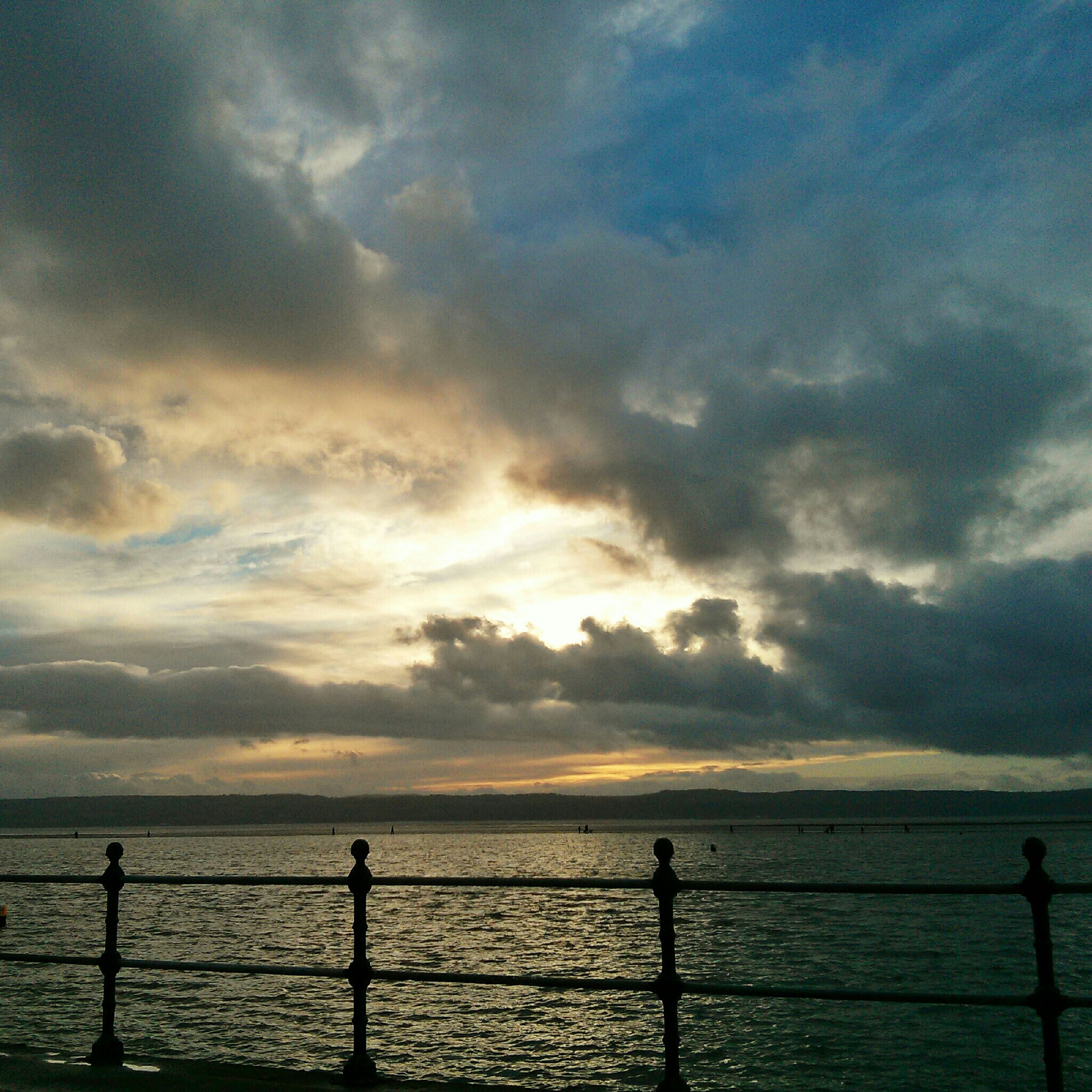sea, water, sky, horizon over water, sunset, scenics, cloud - sky, silhouette, tranquility, beauty in nature, tranquil scene, nature, railing, idyllic, cloud, cloudy, beach, shore, pier, outdoors
