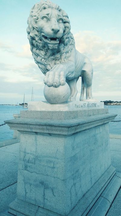 Original image of the North stone Lion Statue after arriving in St Augustine, FL. Stone Material Stone Statue Animal Statues Animal Statue Bay Area Waterfront Inlet Inlet Waters Some Sky Some Water Historic Historical No People Outdoors Day