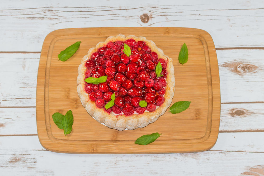 Raspberry cake decorated with mint leaves Bakery Berries Cake Colour Image Desert Food French Cuisine Freshness Gourmet Indulgence Lunch Meal No People Pie Raspberry Raspberry Cake Red Sweet Wooden Board Yummy