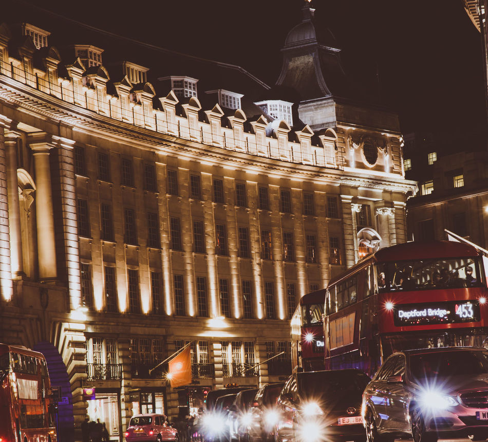 Approaching Architecture Building Exterior Built Structure City City Scene Illuminated London Bus London Buses Low Angle View Motion Motion Blur Night Outdoors Speed Street Traffic Transportation Travel Destinations