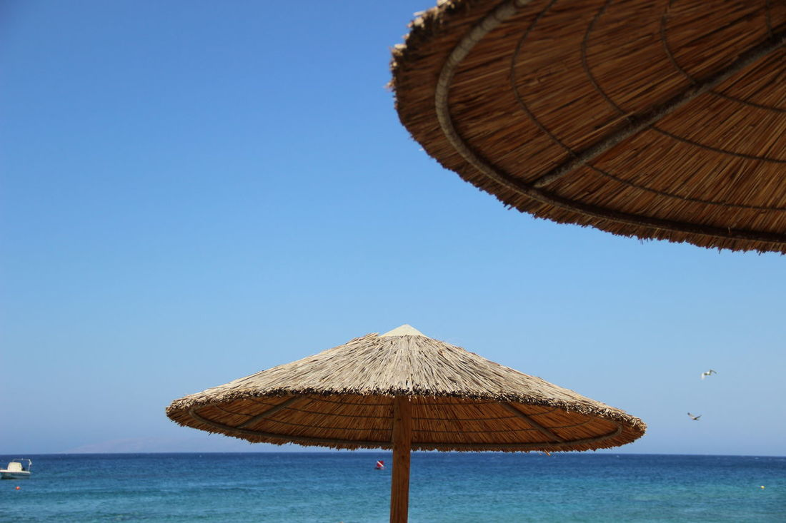 Crete Greece Crete Island Beach Beauty In Nature Blue Clear Sky Crete Crete Heraklion Creteisland Day Heraklion Horizon Over Water Nature No People Outdoors Scenics Sea Sky Thatched Roof Tranquility Water