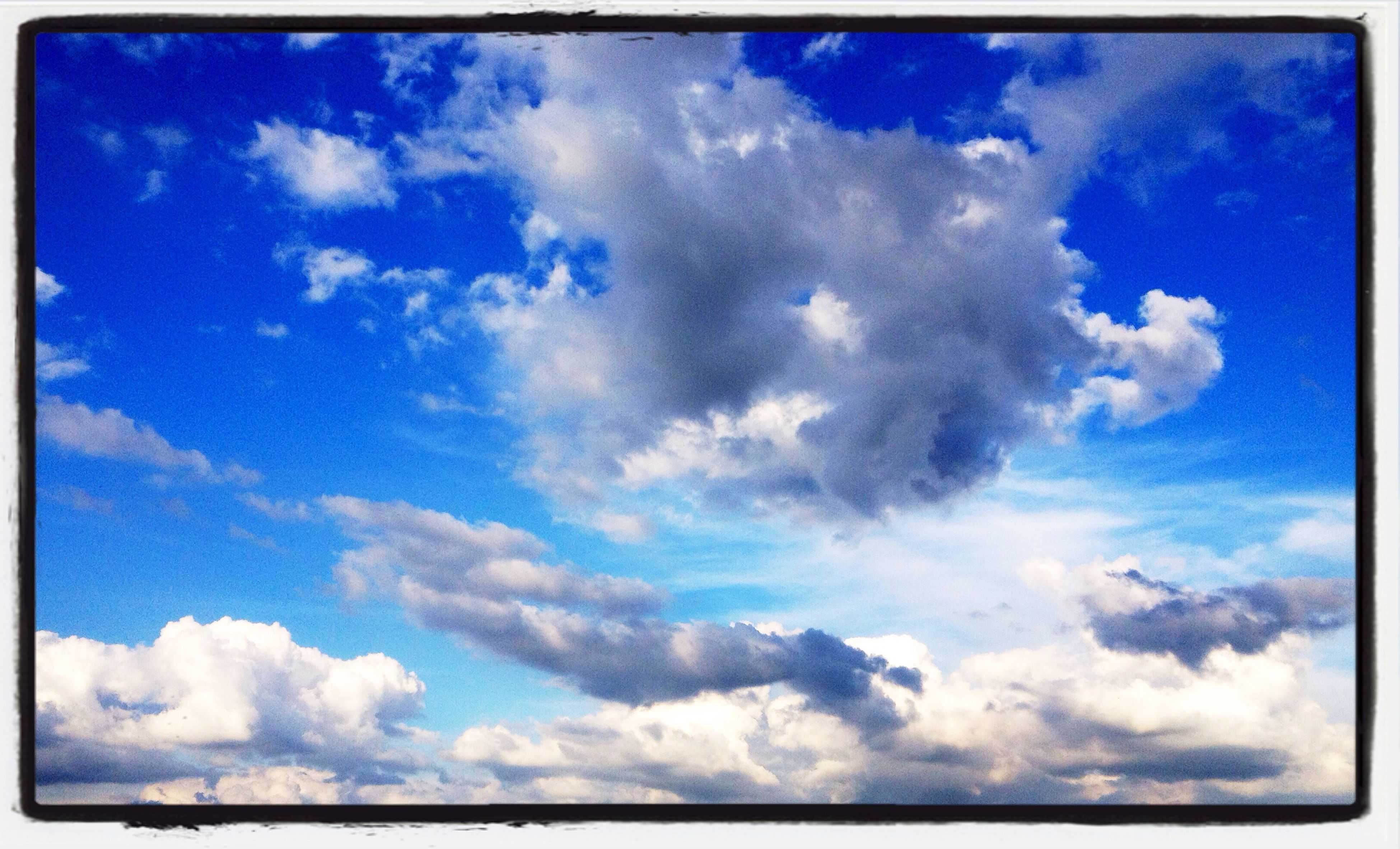 transfer print, blue, sky, cloud - sky, auto post production filter, low angle view, beauty in nature, cloud, tranquility, nature, scenics, tranquil scene, cloudy, cloudscape, sky only, day, backgrounds, outdoors, white color, idyllic
